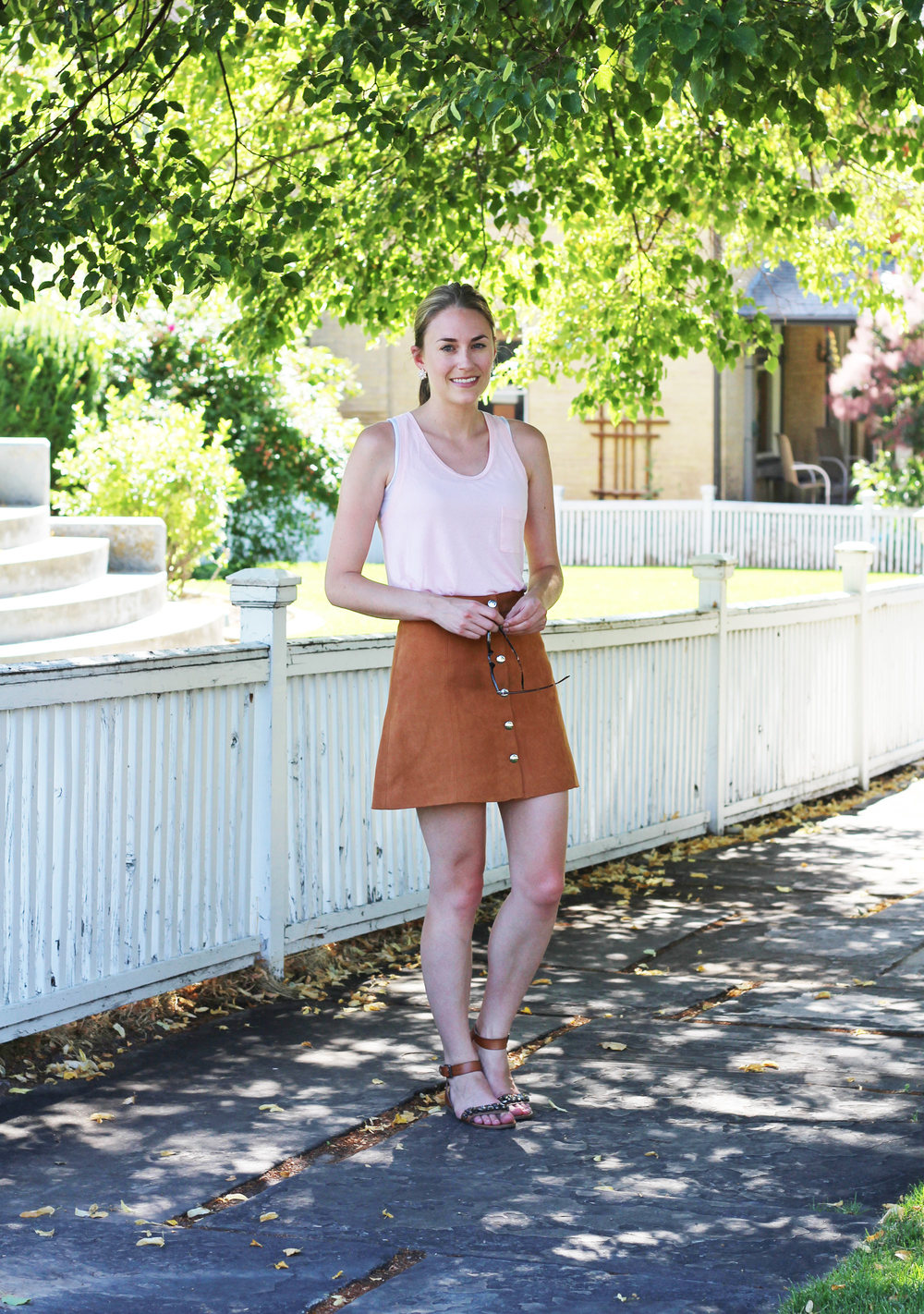 Tan suede skirt outfit with light pink tank top and embellished sandals — Cotton Cashmere Cat Hair