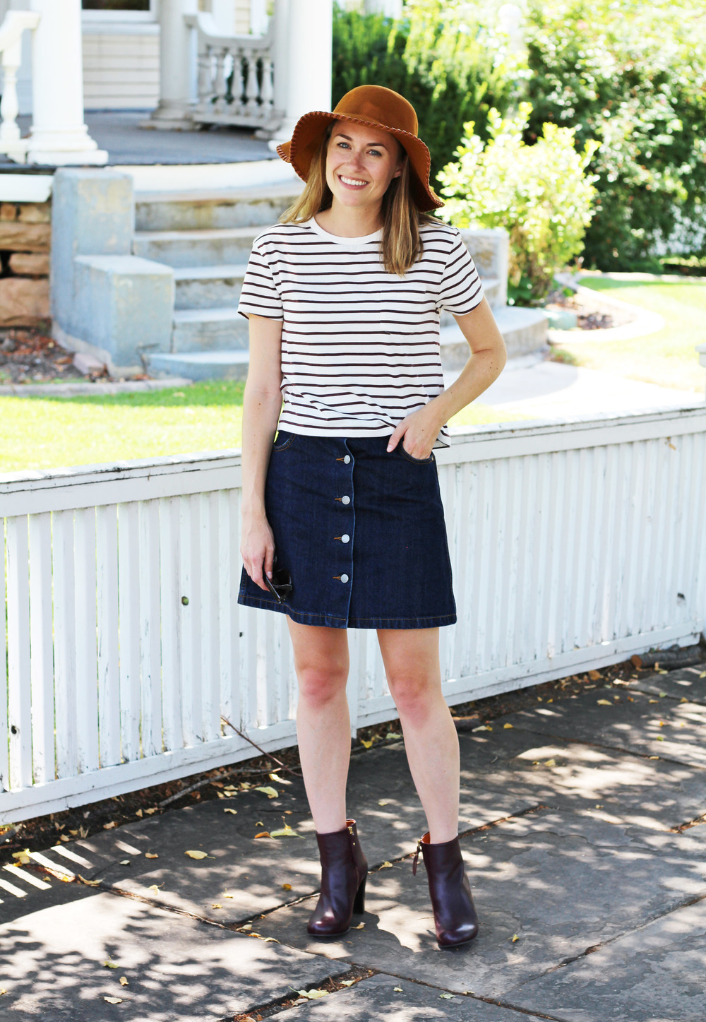 Burgundy striped tee with denim skirt, burgundy ankle boots, and rust floppy hat — Cotton Cashmere Cat Hair