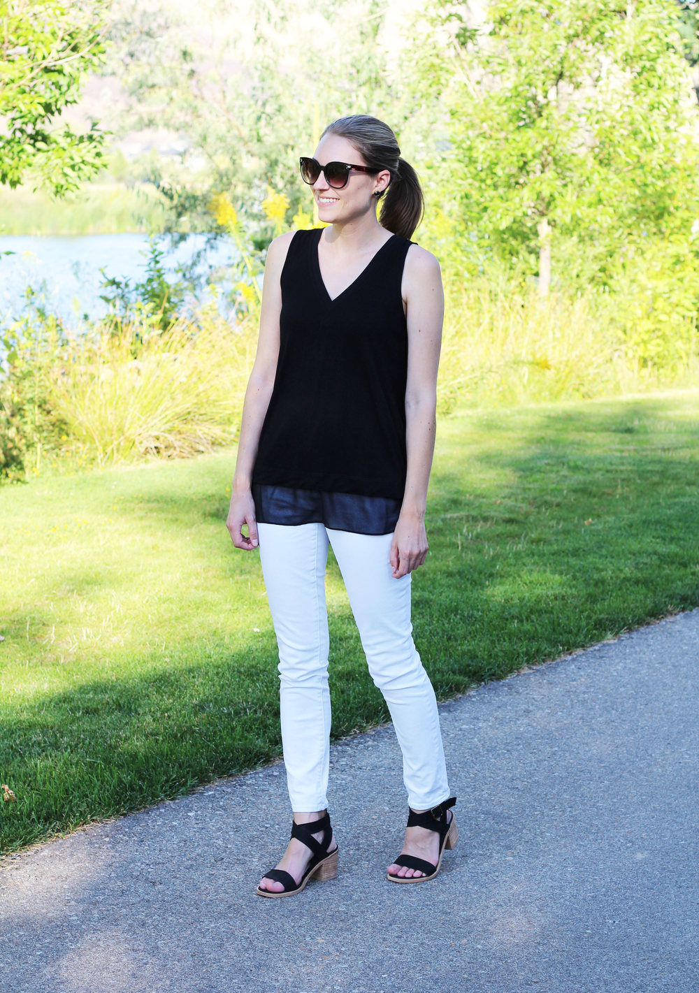 Black layered tank top, white skinny jeans, black block-heel sandals — Cotton Cashmere Cat Hair