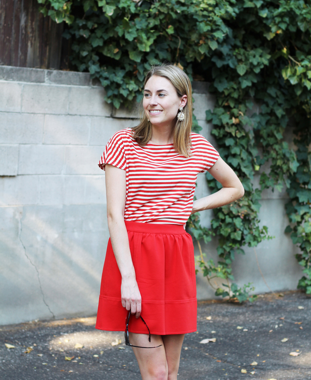 Red stripes + red mini skirt + statement earrings — Cotton Cashmere Cat Hair