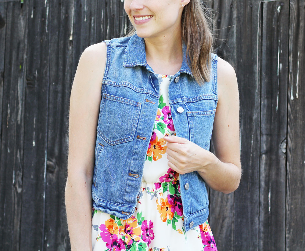 Denim vest layered over a floral dress — Cotton Cashmere Cat Hair