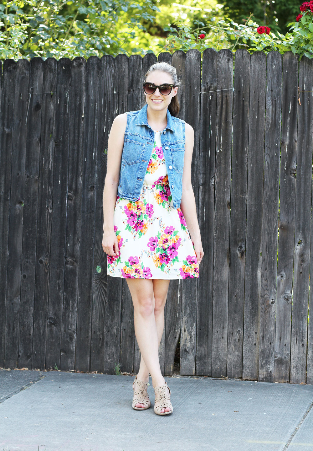 Denim vest outfit with floral dress and neutral sandals — Cotton Cashmere Cat Hair