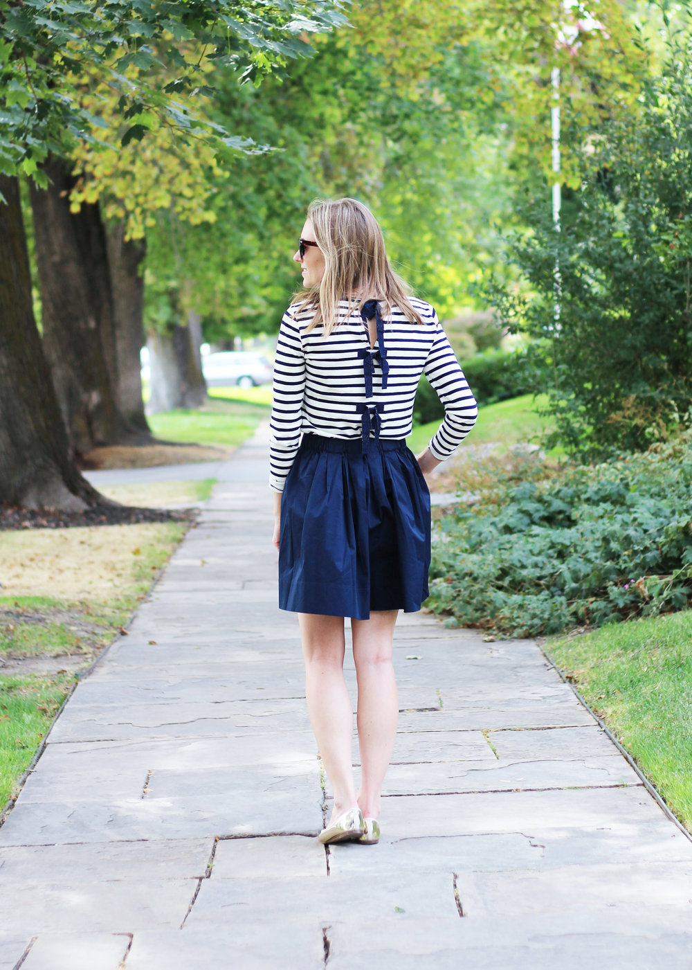 Navy striped bow-embellished tee, Everlane navy cotton poplin skirt, gold flats — Cotton Cashmere Cat Hair