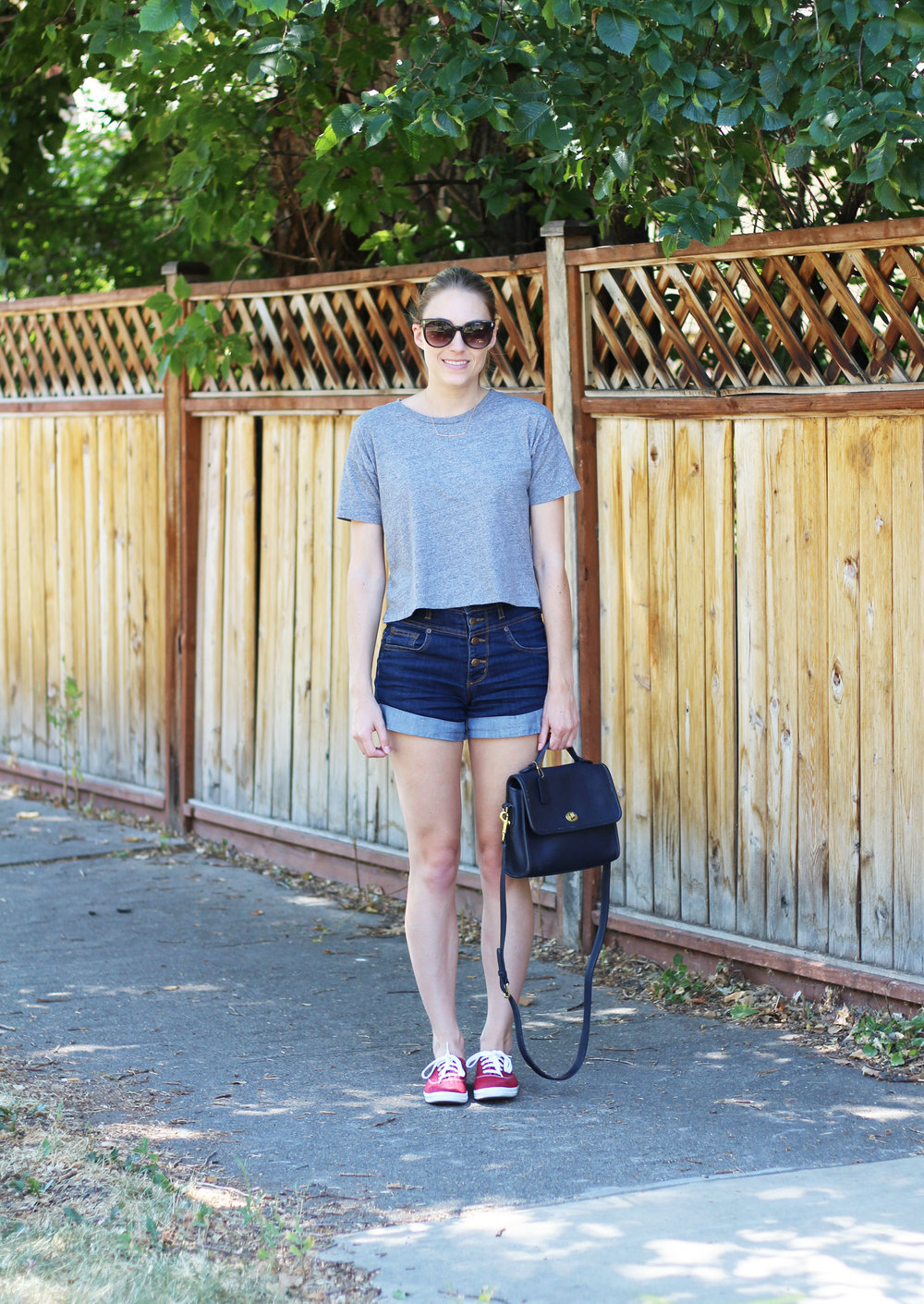 High rise denim shorts outfit with grey cropped tee, red Keds, navy vintage Coach bag — Cotton Cashmere Cat Hair