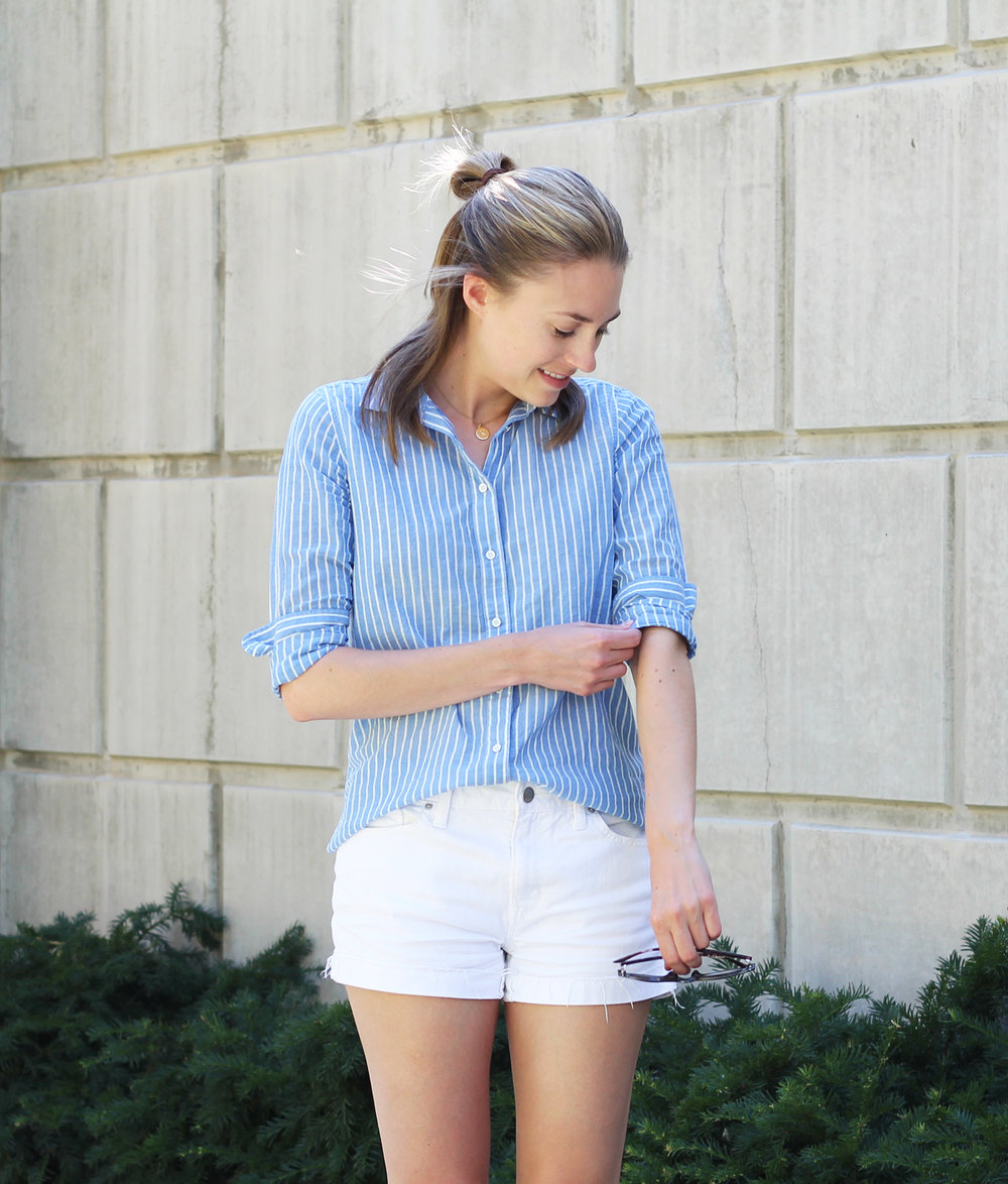 White denim shorts outfit with blue striped button-up shirt — Cotton Cashmere Cat Hair