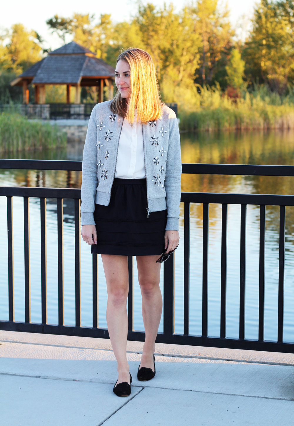 Embellished bomber jacket with collared button-up blouse, black mini skirt, black loafers — Cotton Cashmere Cat Hair