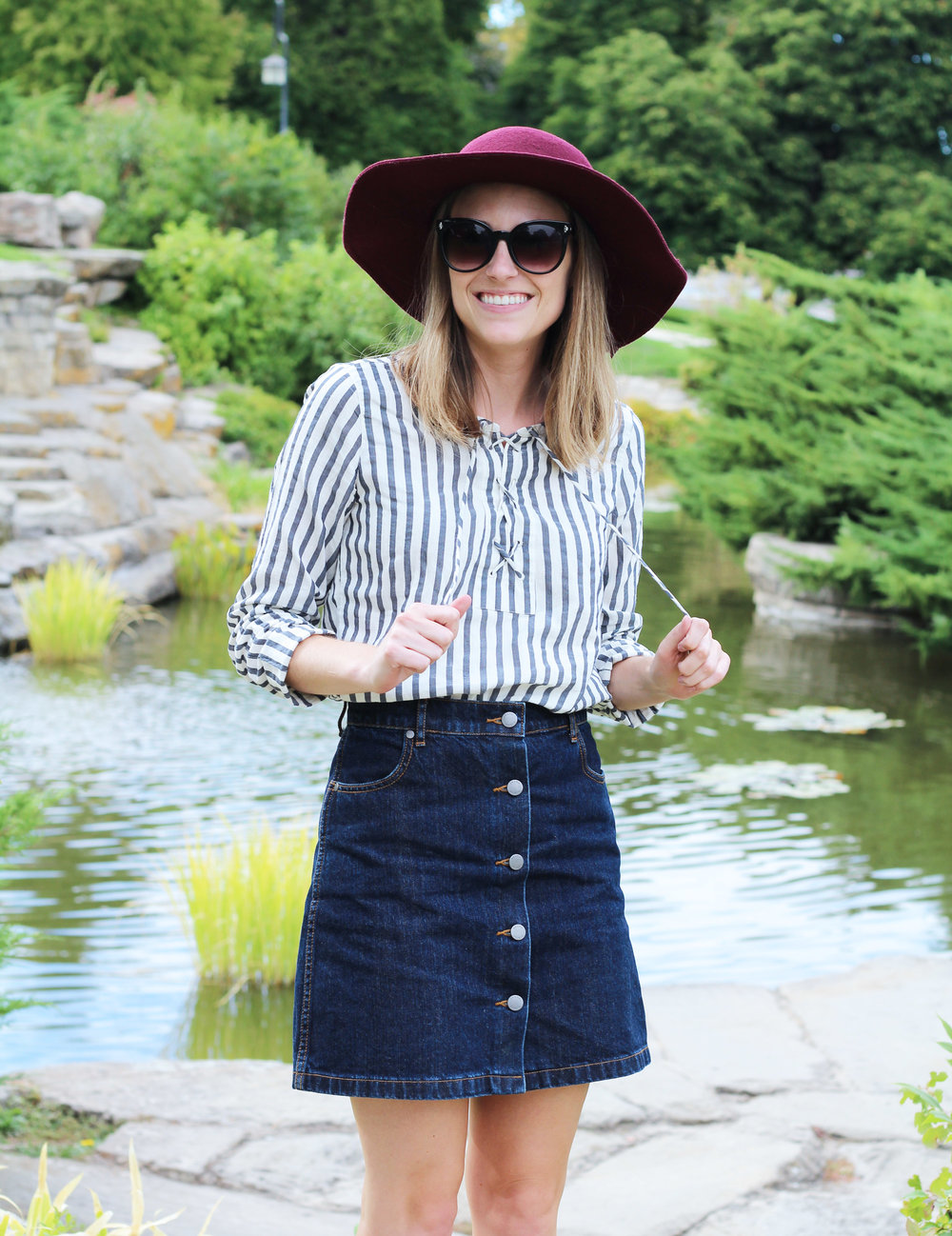 Denim skirt outfit with striped lace-up blouse and burgundy floppy hat — Cotton Cashmere Cat Hair
