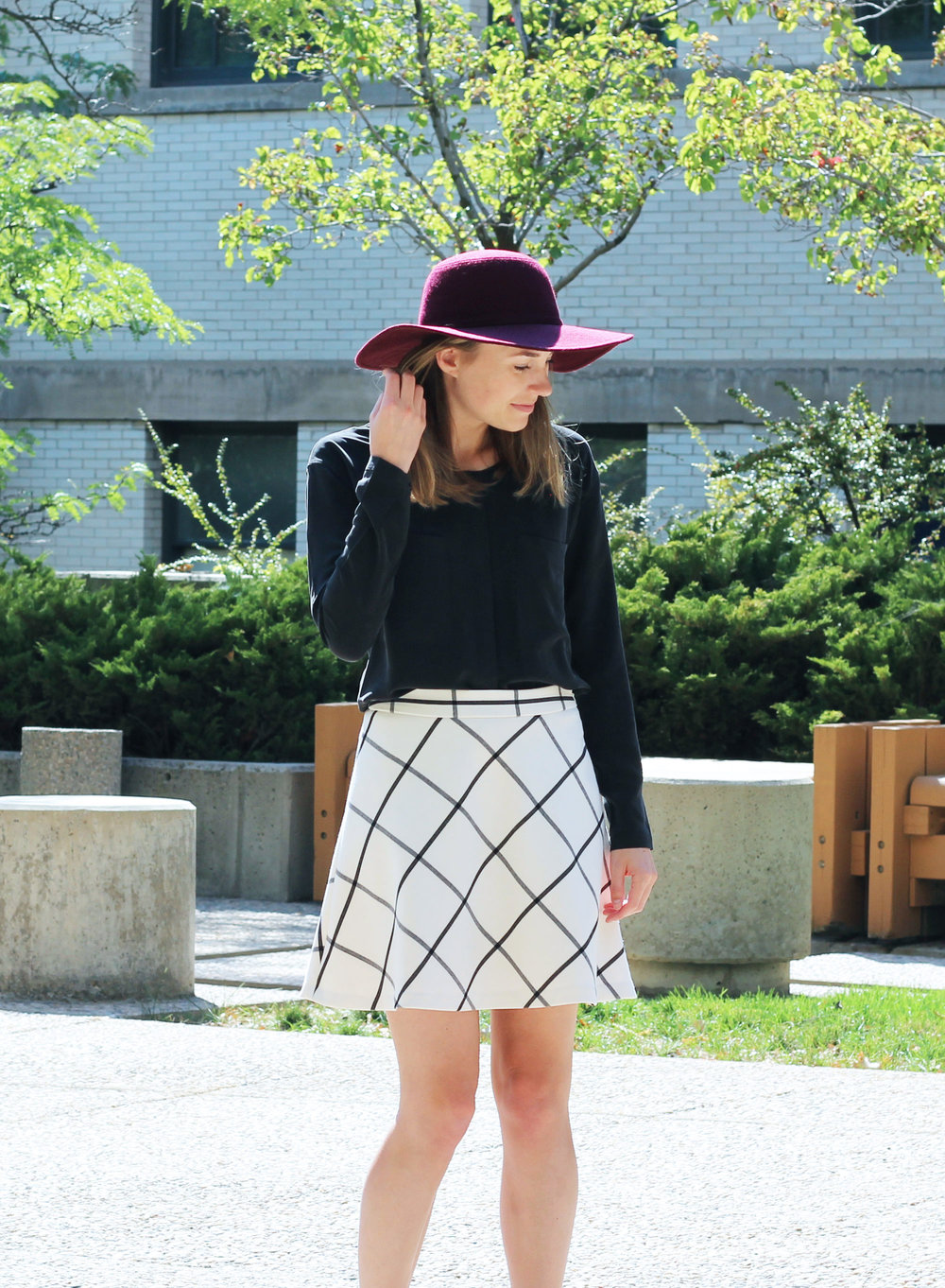 Burgundy floppy hat + black silk shirt + windowpane skirt — Cotton Cashmere Cat Hair