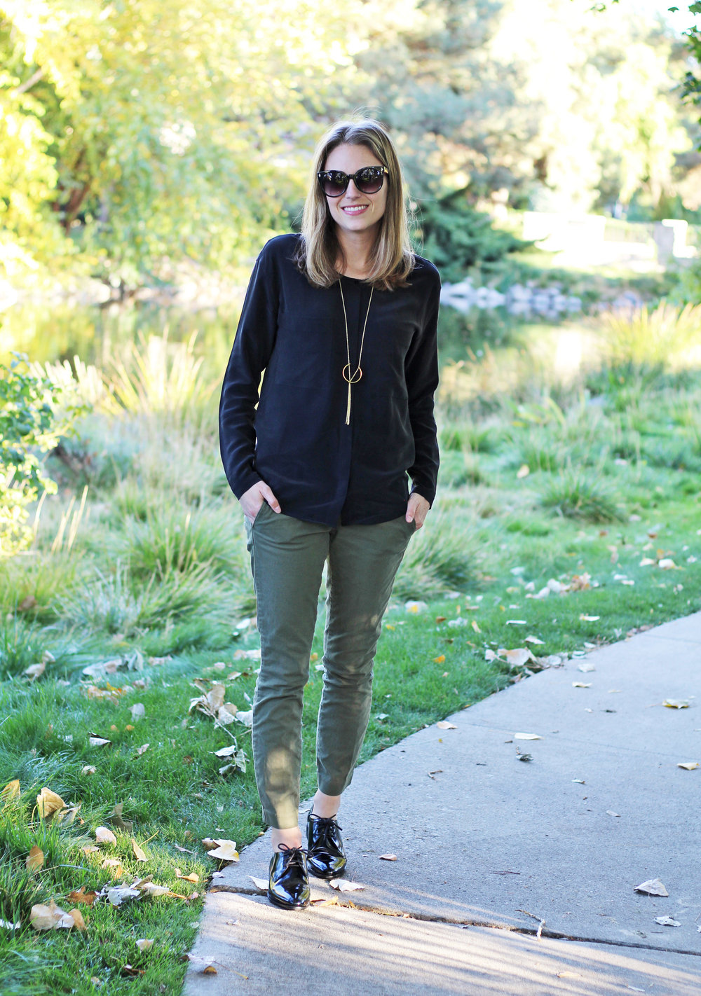 Everlane 'Silk Pocket Tee' outfit with green chinos, shiny black oxfords, pendant necklace — Cotton Cashmere Cat Hair