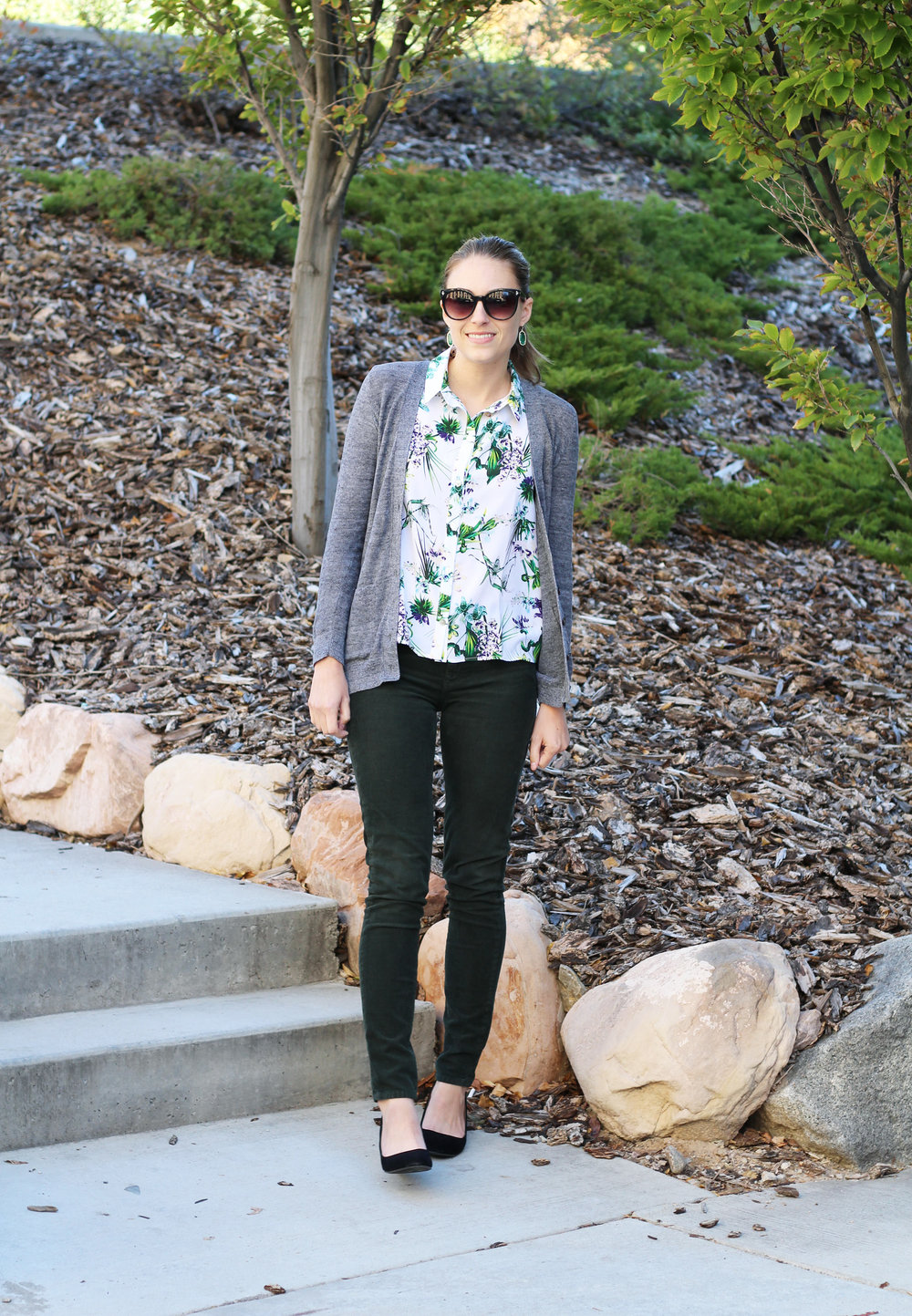 Tropical print silk shirt, grey cardigan, forest green corduroy pants, black wedges, green statement earrings — Cotton Cashmere Cat Hair