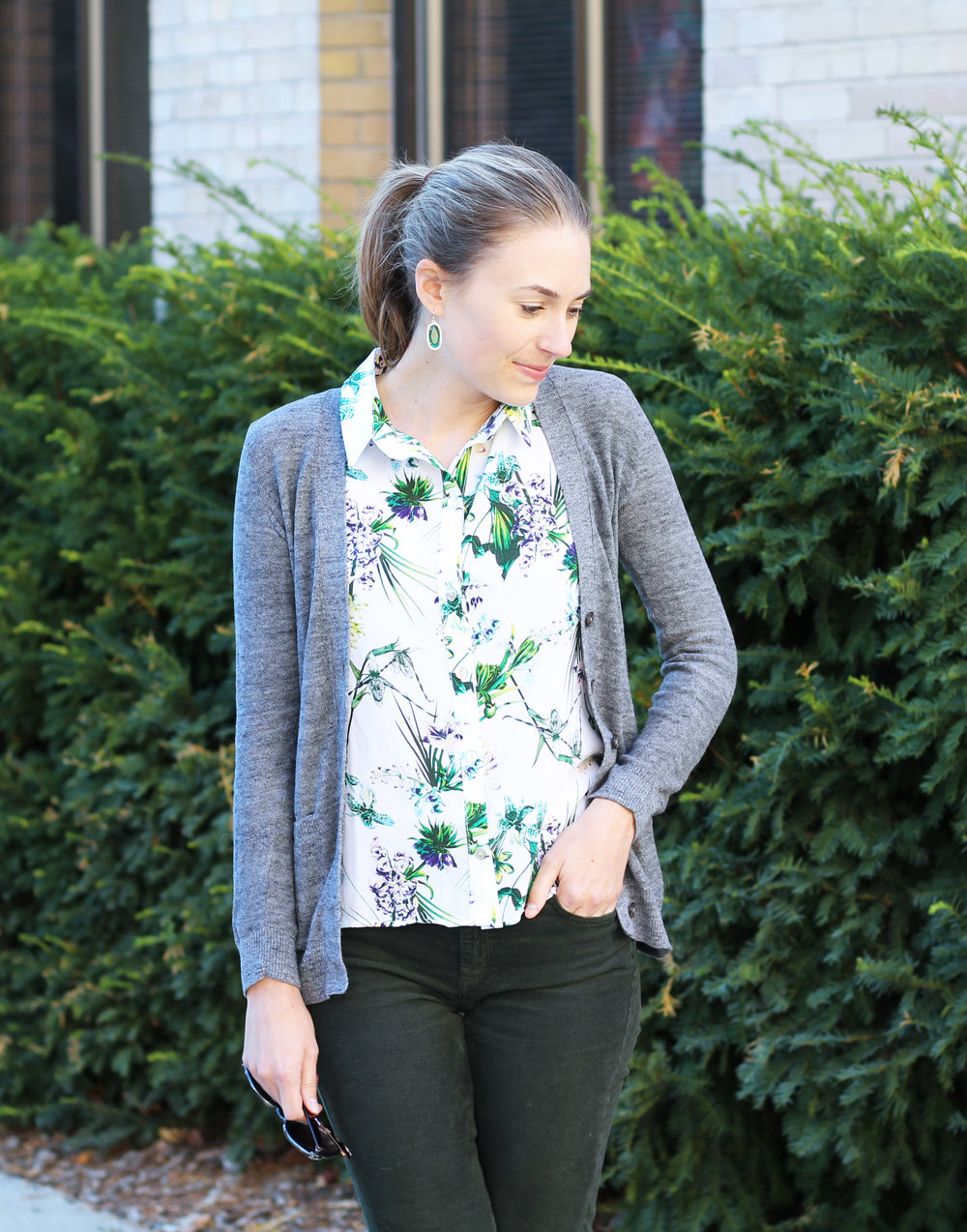 Tropical-print silk shirt with grey cardigan, green corduroy pants, Kendra Scott earrings — Cotton Cashmere Cat Hair