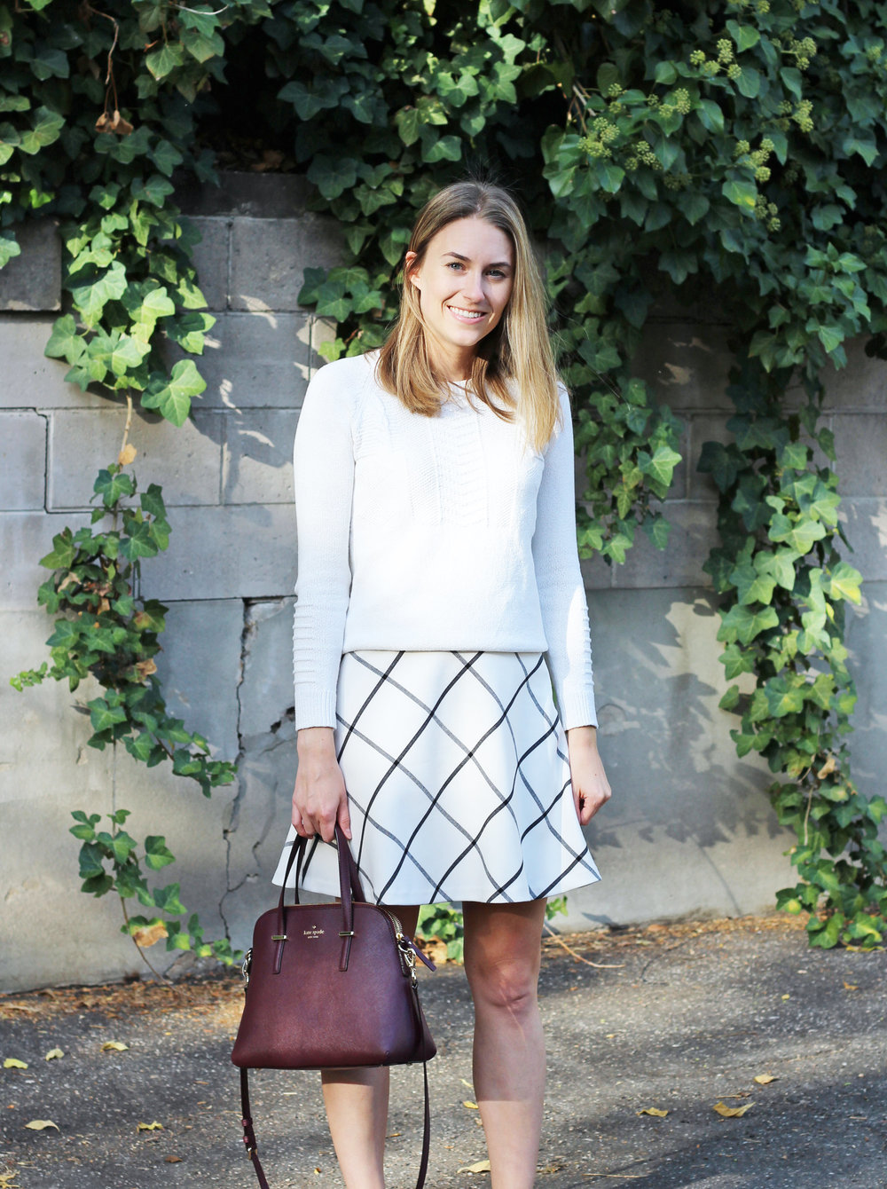 Fall outfit with ivory sweater, windowpane skirt, burgundy Kate Spade bag — Cotton Cashmere Cat Hair