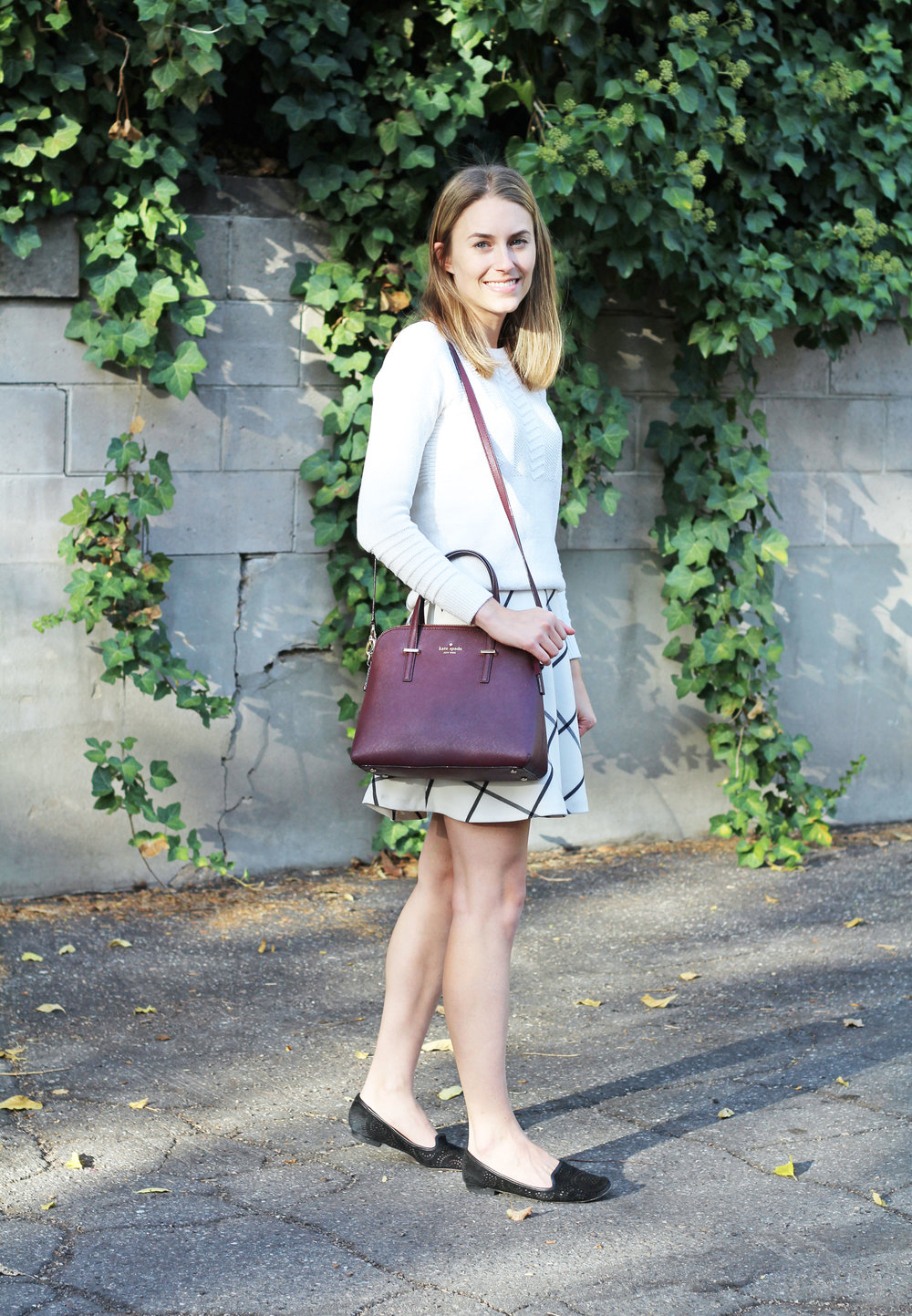 Ivory sweater outfit with windowpane skirt, black loafers, burgundy bag — Cotton Cashmere Cat Hair