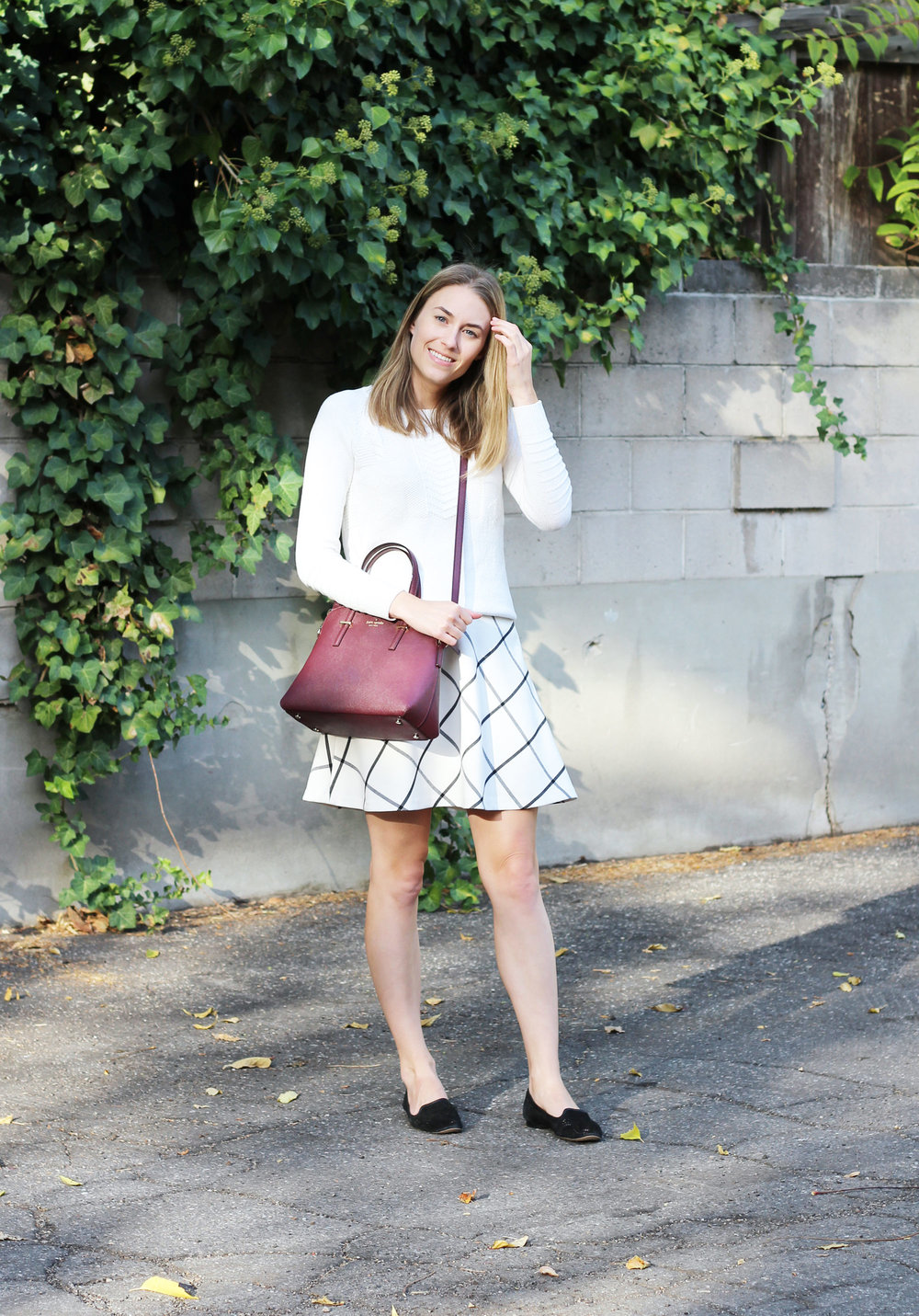 Fall outfit with ivory sweater, windowpane skirt, black loafers, burgundy bag — Cotton Cashmere Cat Hair