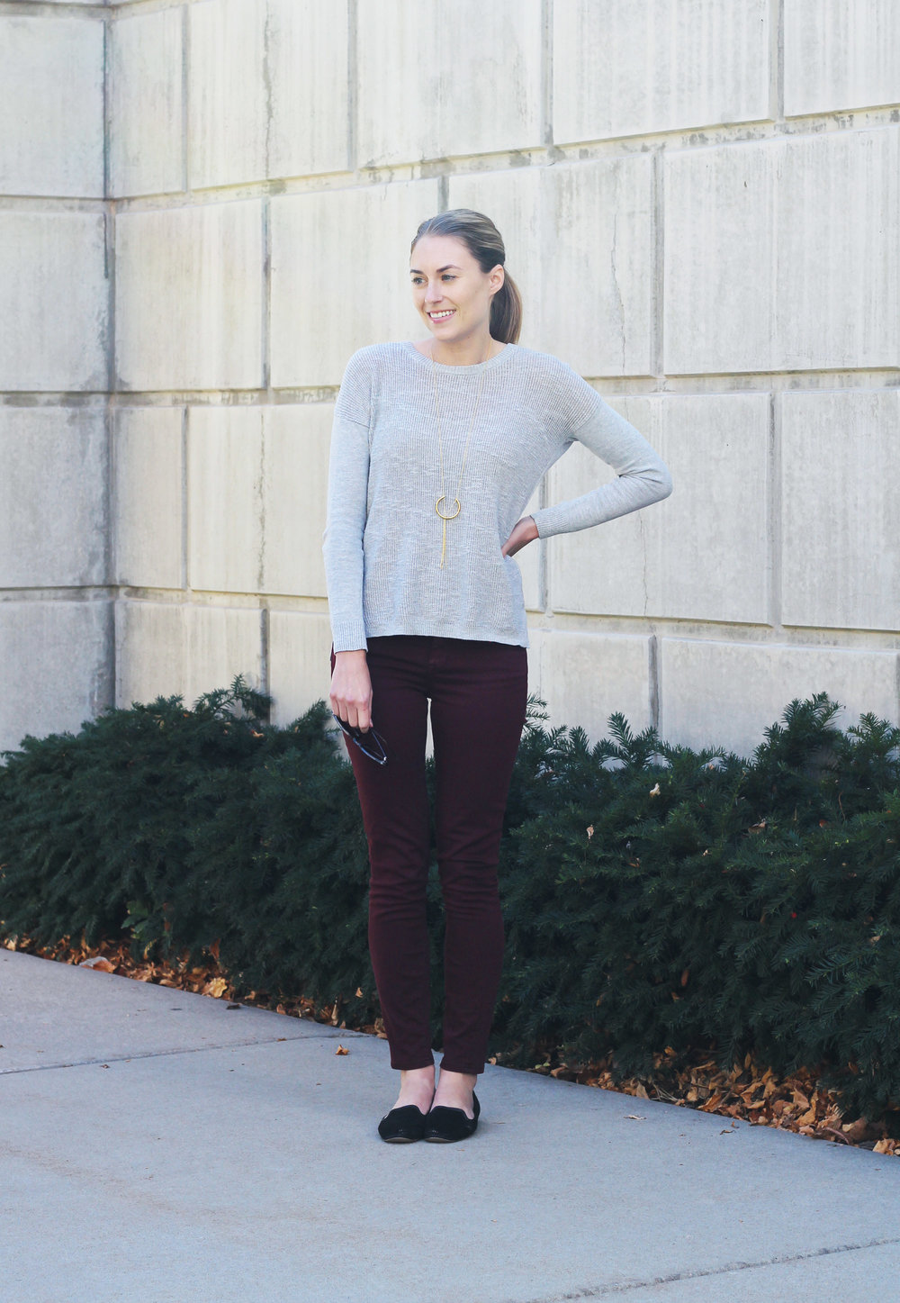 Burgundy pants outfit with grey sweater, black loafers, pendant necklace — Cotton Cashmere Cat Hair