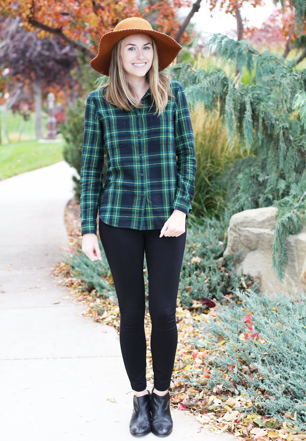 Shades of autumn in a green plaid flannel shirt and rust floppy hat — Cotton Cashmere Cat Hair