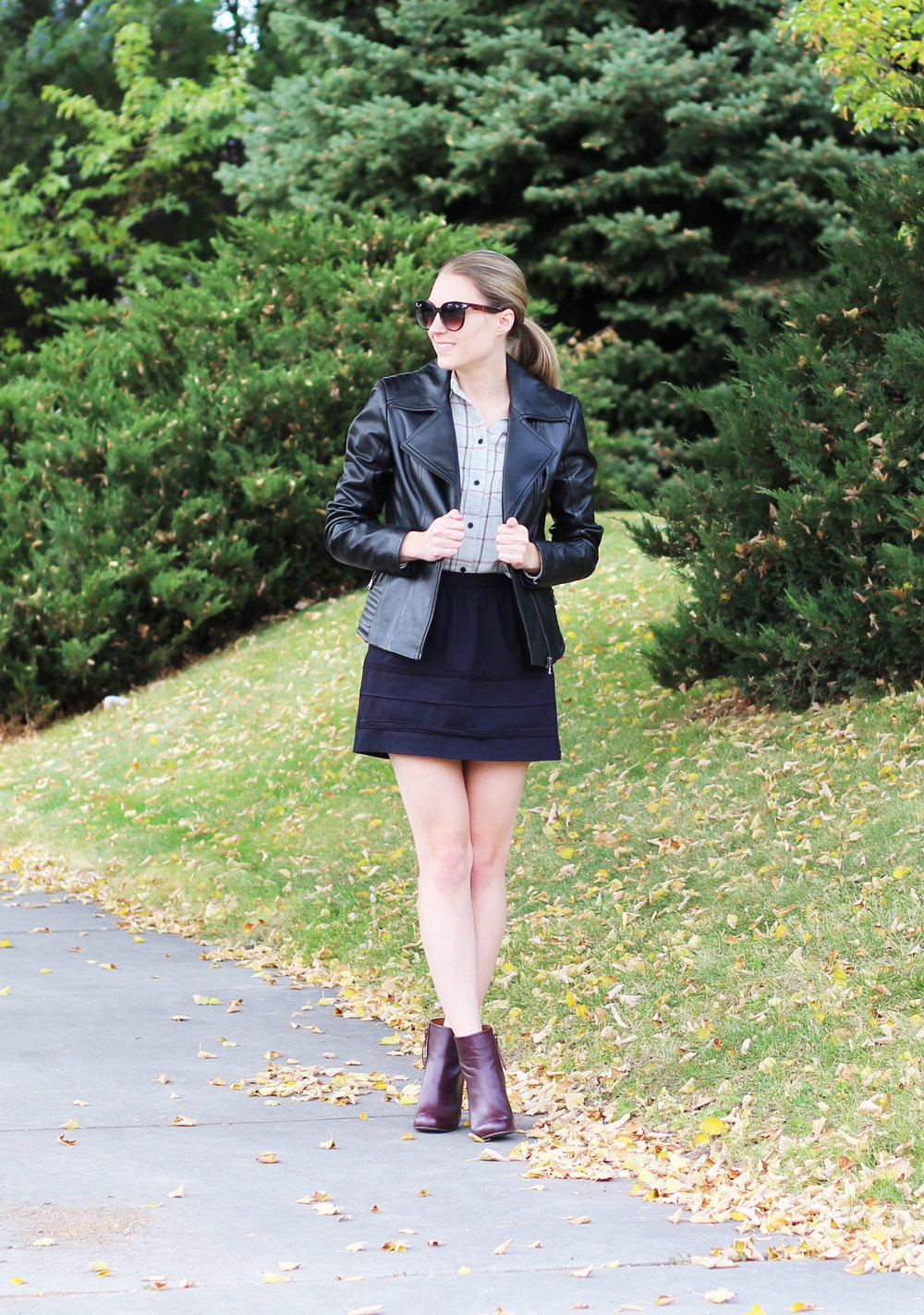 Leather jacket outfit with grey flannel shirt, black mini skirt, red ankle boots — Cotton Cashmere Cat Hair