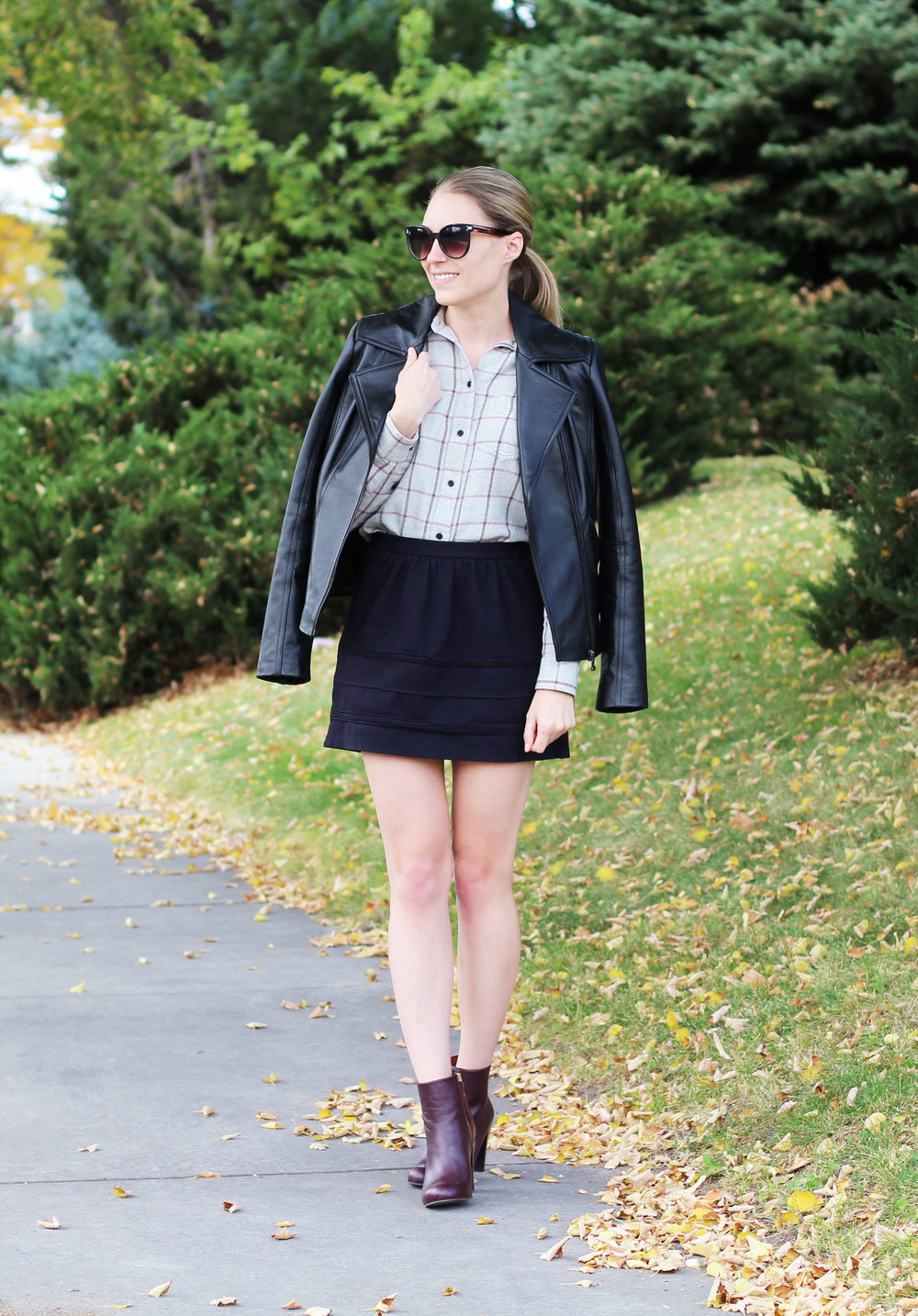 Fall outfit with leather jacket, flannel shirt, black mini skirt, red ankle boots — Cotton Cashmere Cat Hair