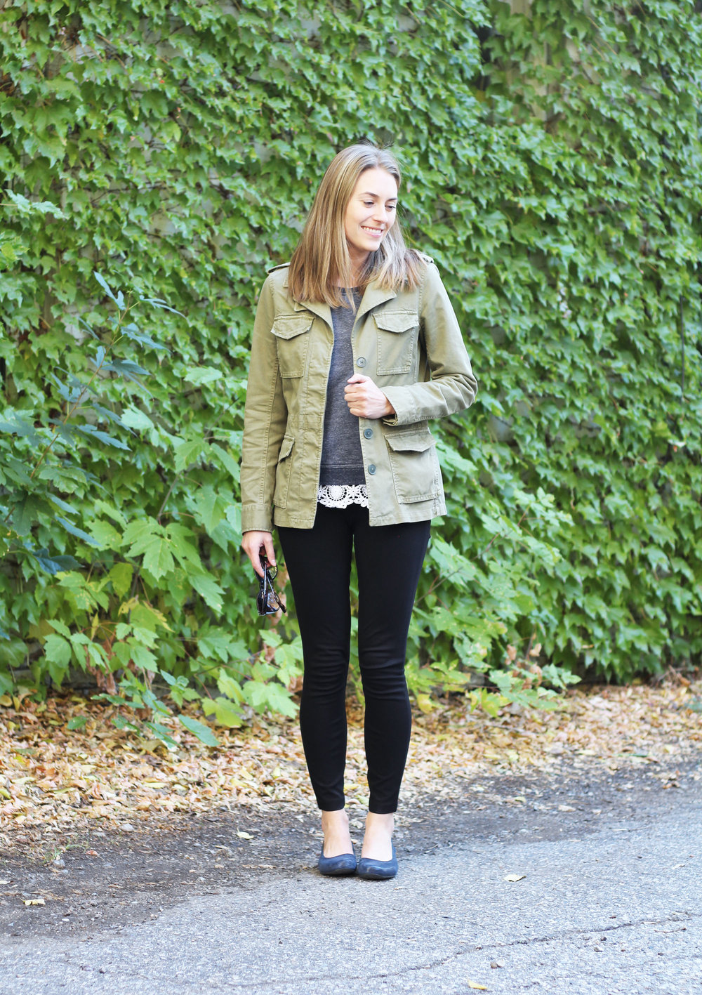 Utility jacket outfit with navy sweatshirt, lace top, black pants, navy flats — Cotton Cashmere Cat Hair