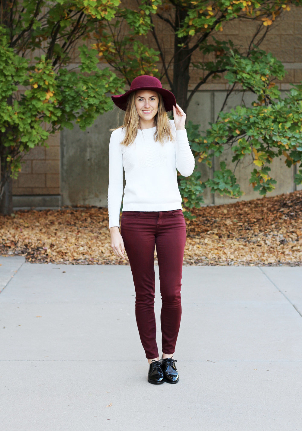 Burgundy floppy hat outfit with ivory sweater, burgundy pants, black oxfords — Cotton Cashmere Cat Hair