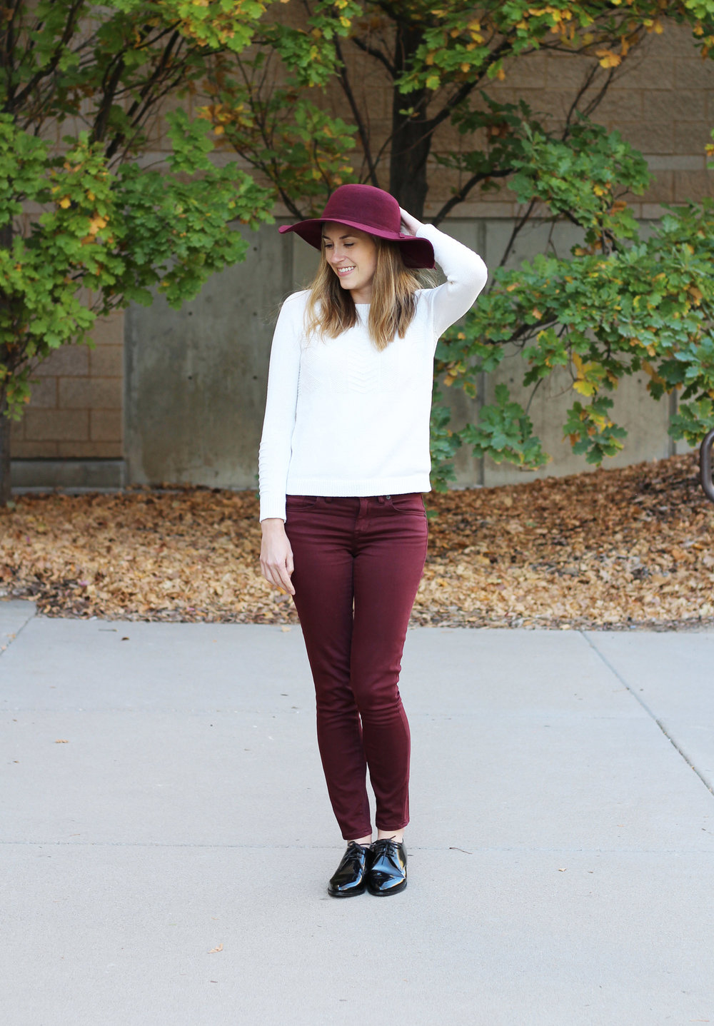 Burgundy pants outfit with ivory sweater, black oxfords, burgundy floppy hat — Cotton Cashmere Cat Hair