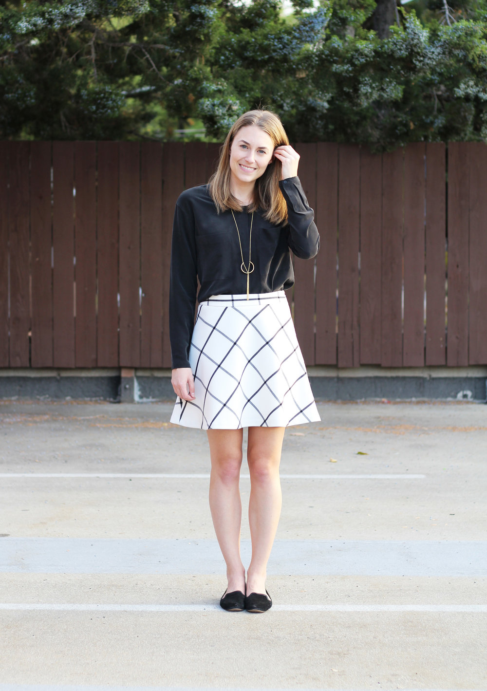 Windowpane skirt outfit with black silk top, black loafers, pendant necklace — Cotton Cashmere Cat Hair