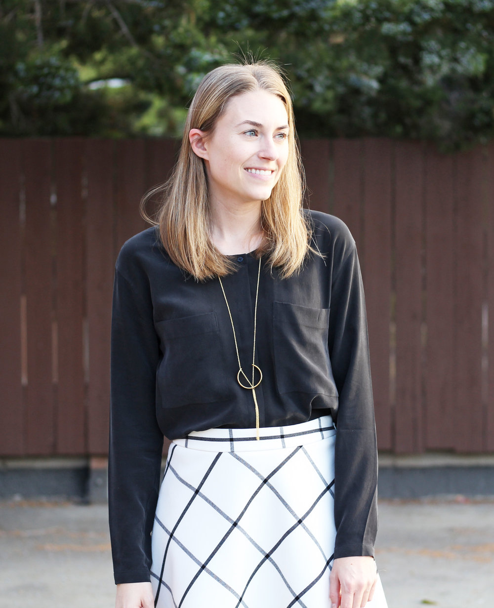 Windowpane skirt with black top and pendant necklace — Cotton Cashmere Cat Hair