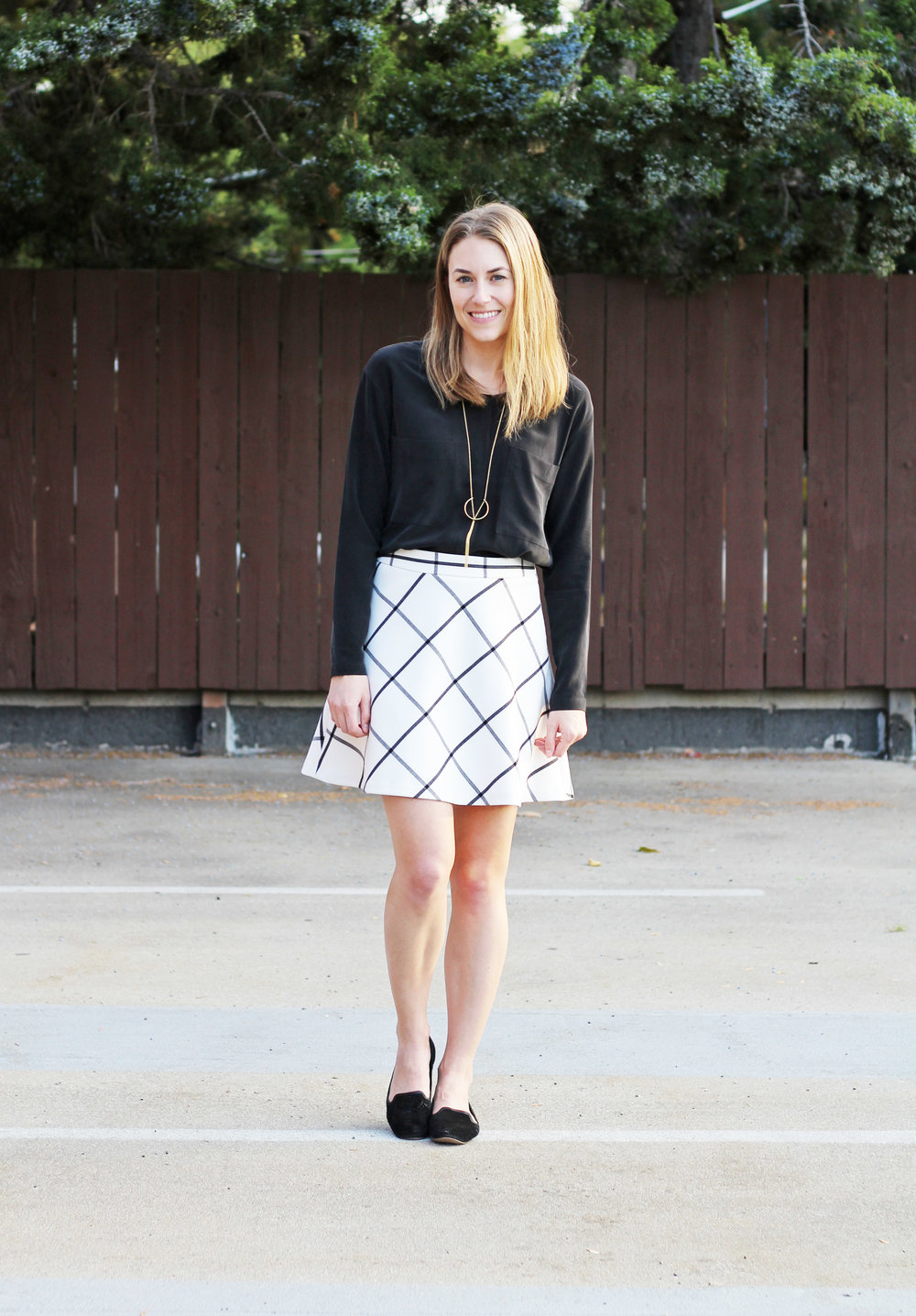 Windowpane skirt outfit with black silk shirt, black loafers, pendant necklace — Cotton Cashmere Cat Hair