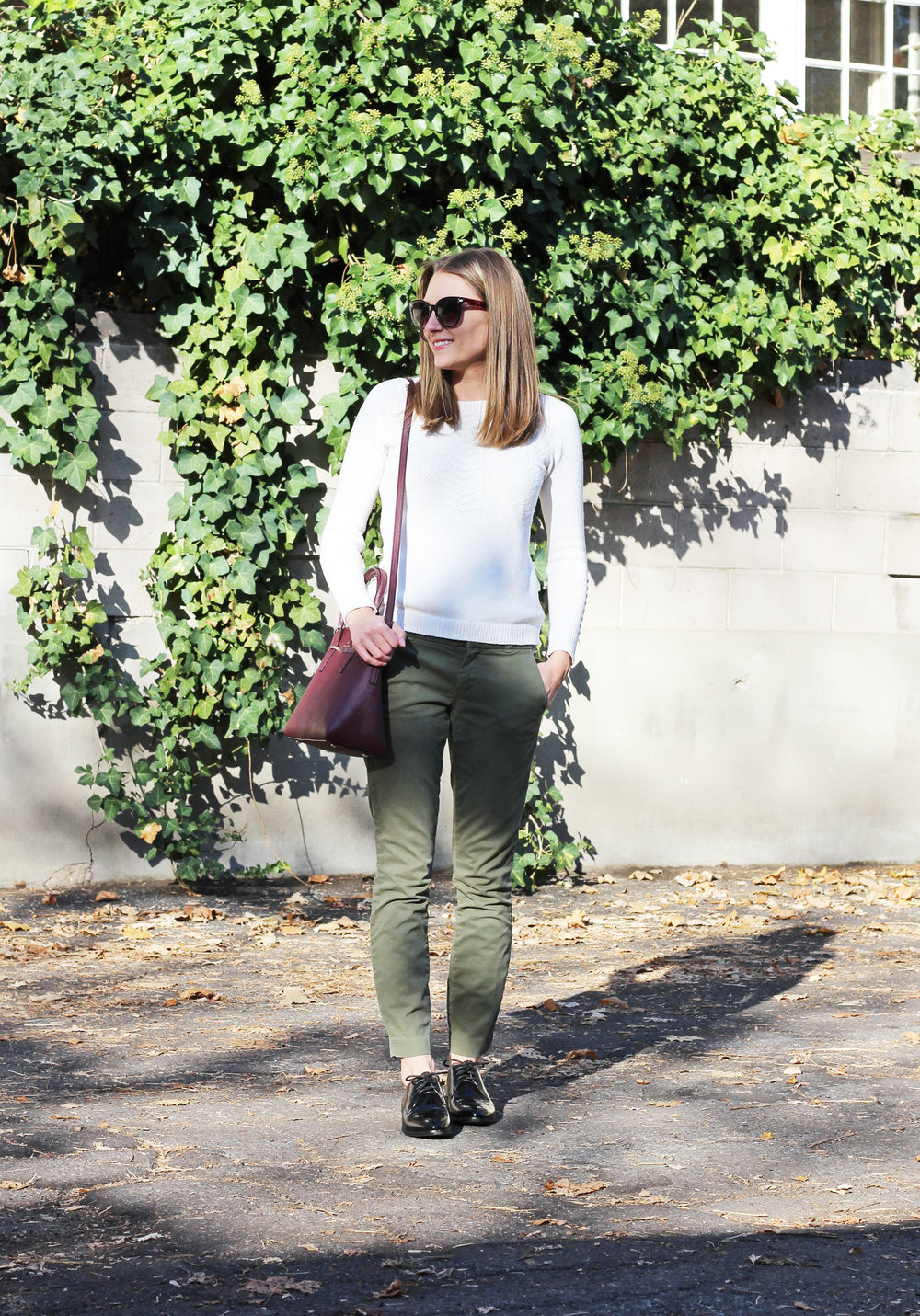 Autumn neutrals: Ivory sweater, army green pants, black oxfords, burgundy bag — Cotton Cashmere Cat Hair
