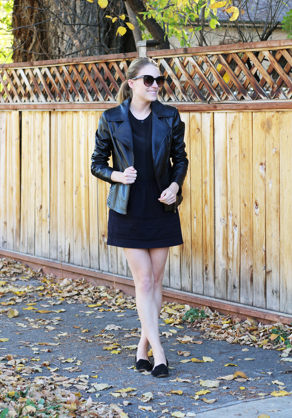 All black outfit with leather jacket, silk shirt, mini skirt, loafers — Cotton Cashmere Cat Hair