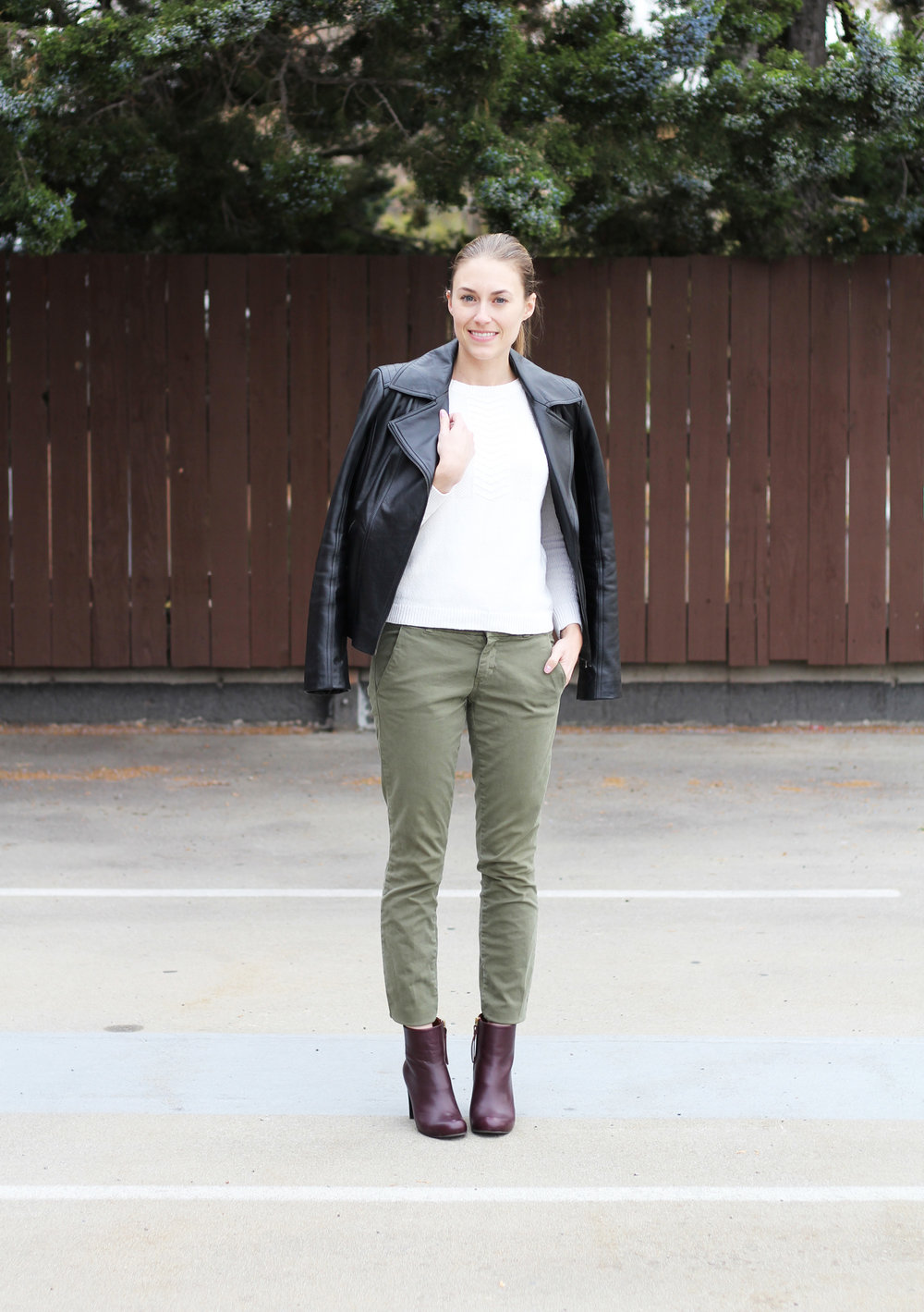 Leather jacket outfit with ivory sweater, green pants, burgundy ankle boots — Cotton Cashmere Cat Hair