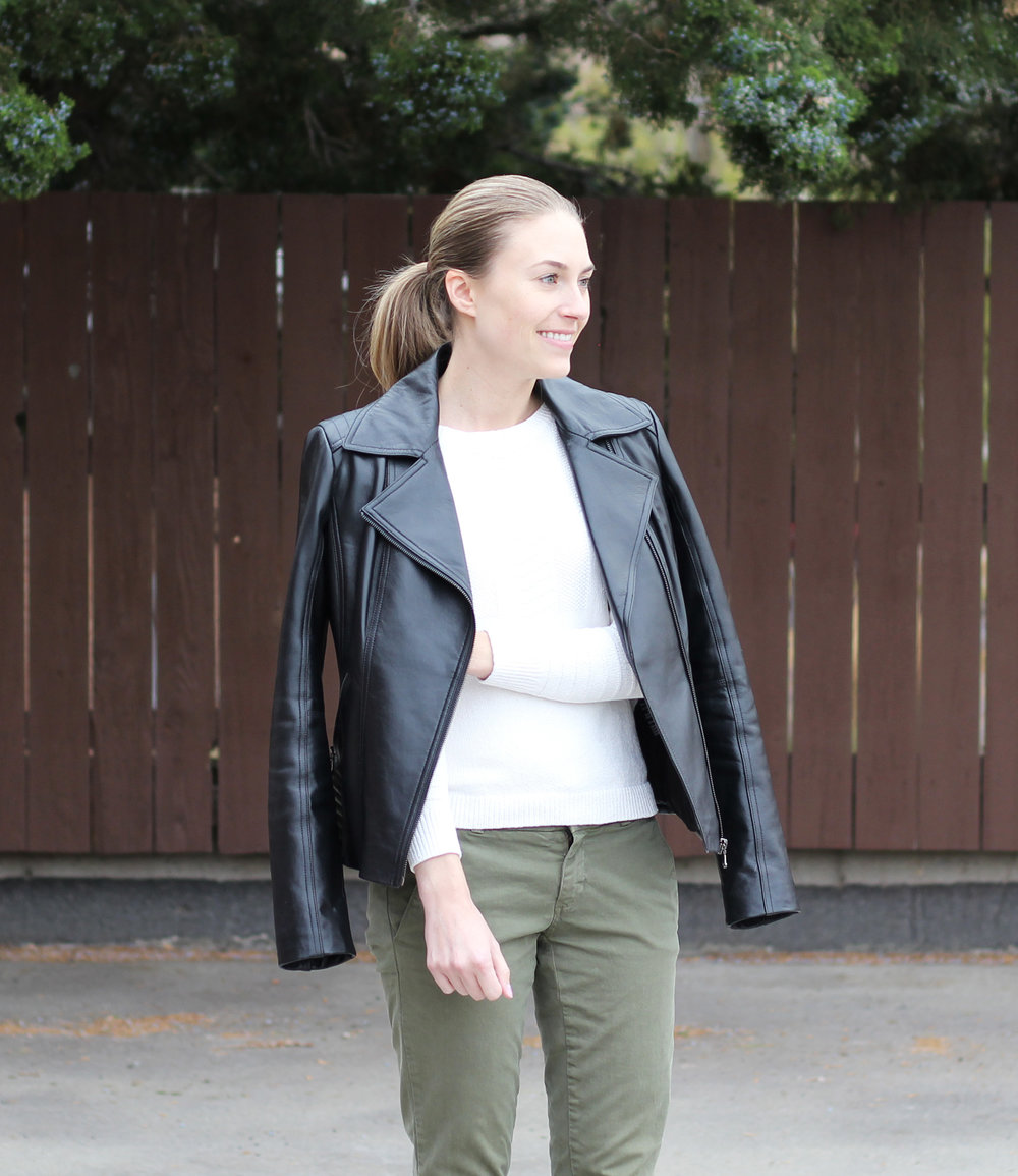 Leather jacket outfit with ivory sweater and green pants — Cotton Cashmere Cat Hair