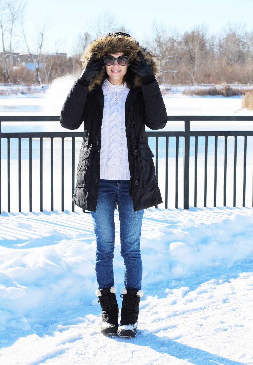 Black parka outfit with ivory cable knit sweater, skinny jeans, Sorel boots — Cotton Cashmere Cat Hair