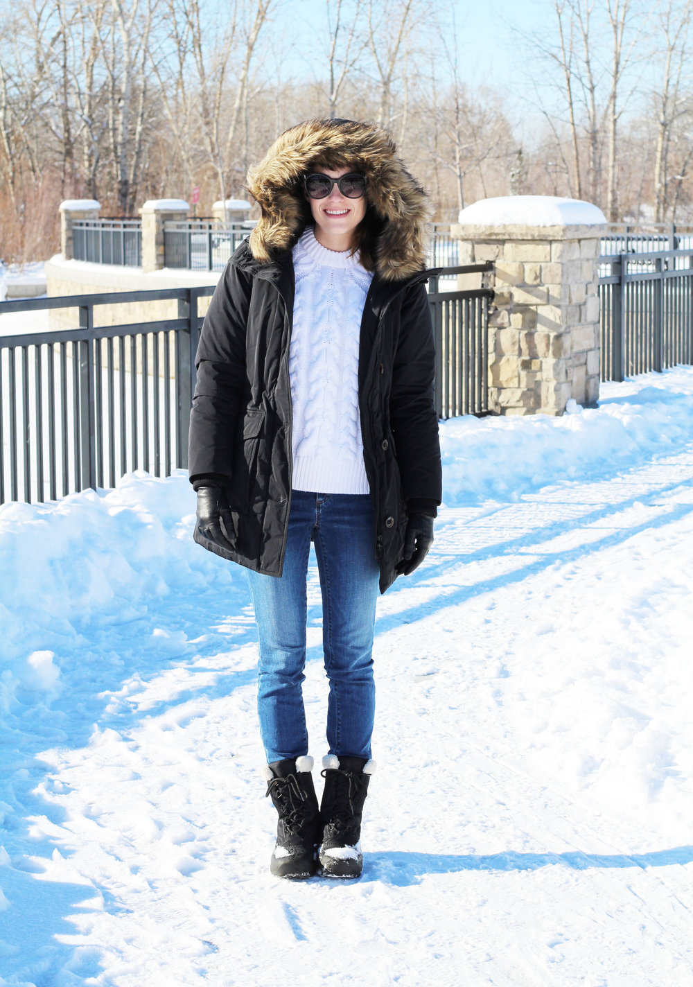 Sorel Cumberland boots outfit with black parka, cable knit sweater, skinny jeans — Cotton Cashmere Cat Hair
