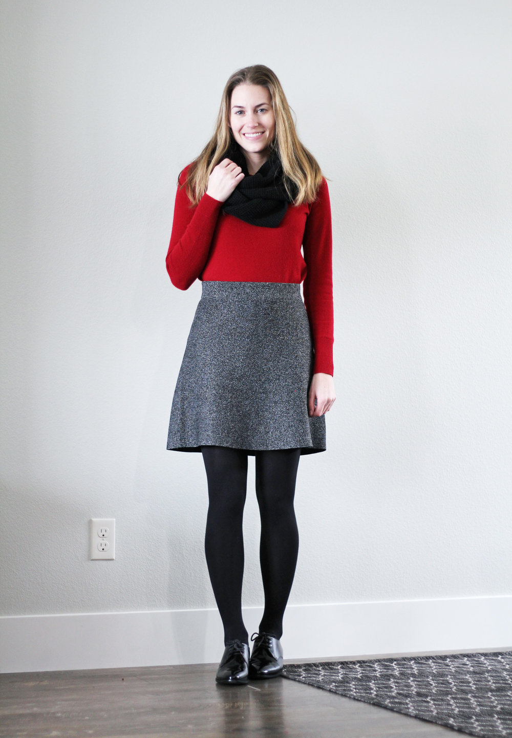Red sweater outfit with speckled skirt, black oxfords, black scarf — Cotton Cashmere Cat Hair
