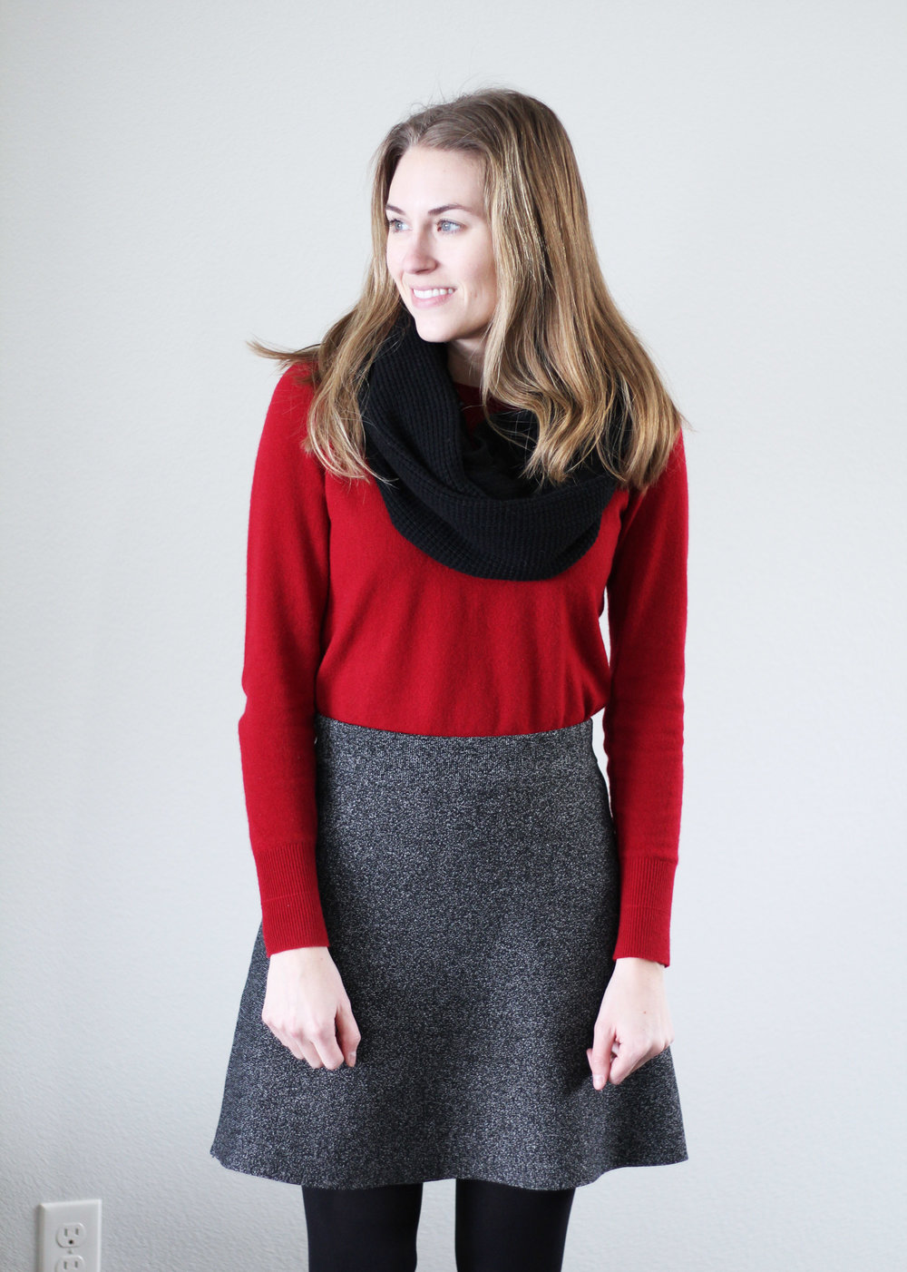 Red cashmere sweater, black speckled skirt, black scarf — Cotton Cashmere Cat Hair