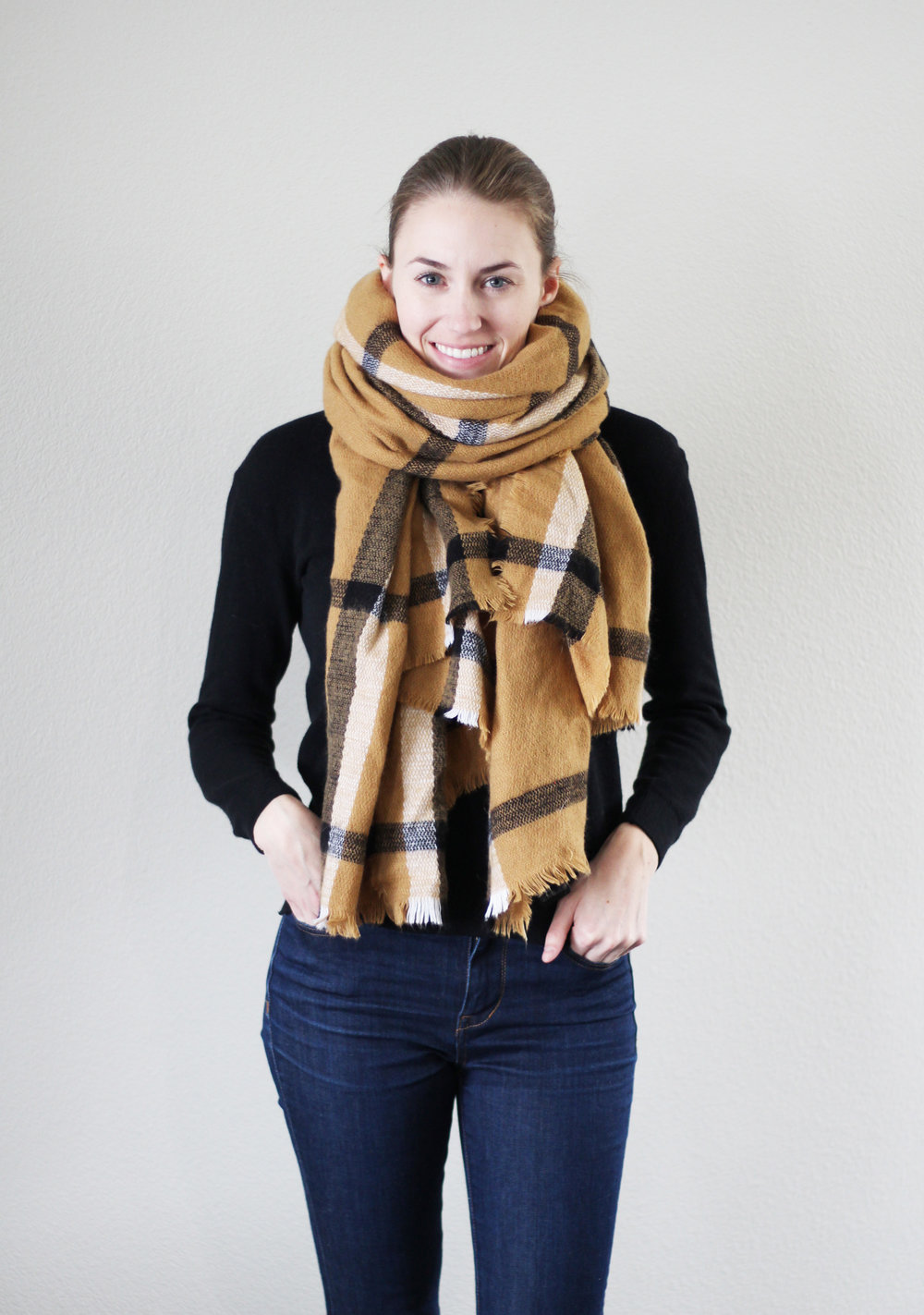 Camel blanket scarf, black sweater, high rise skinny jeans — Cotton Cashmere Cat Hair