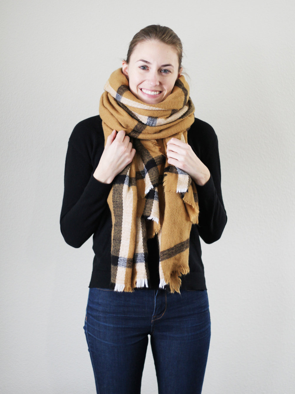 Plaid camel blanket scarf outfit with black sweater and skinny jeans — Cotton Cashmere Cat Hair