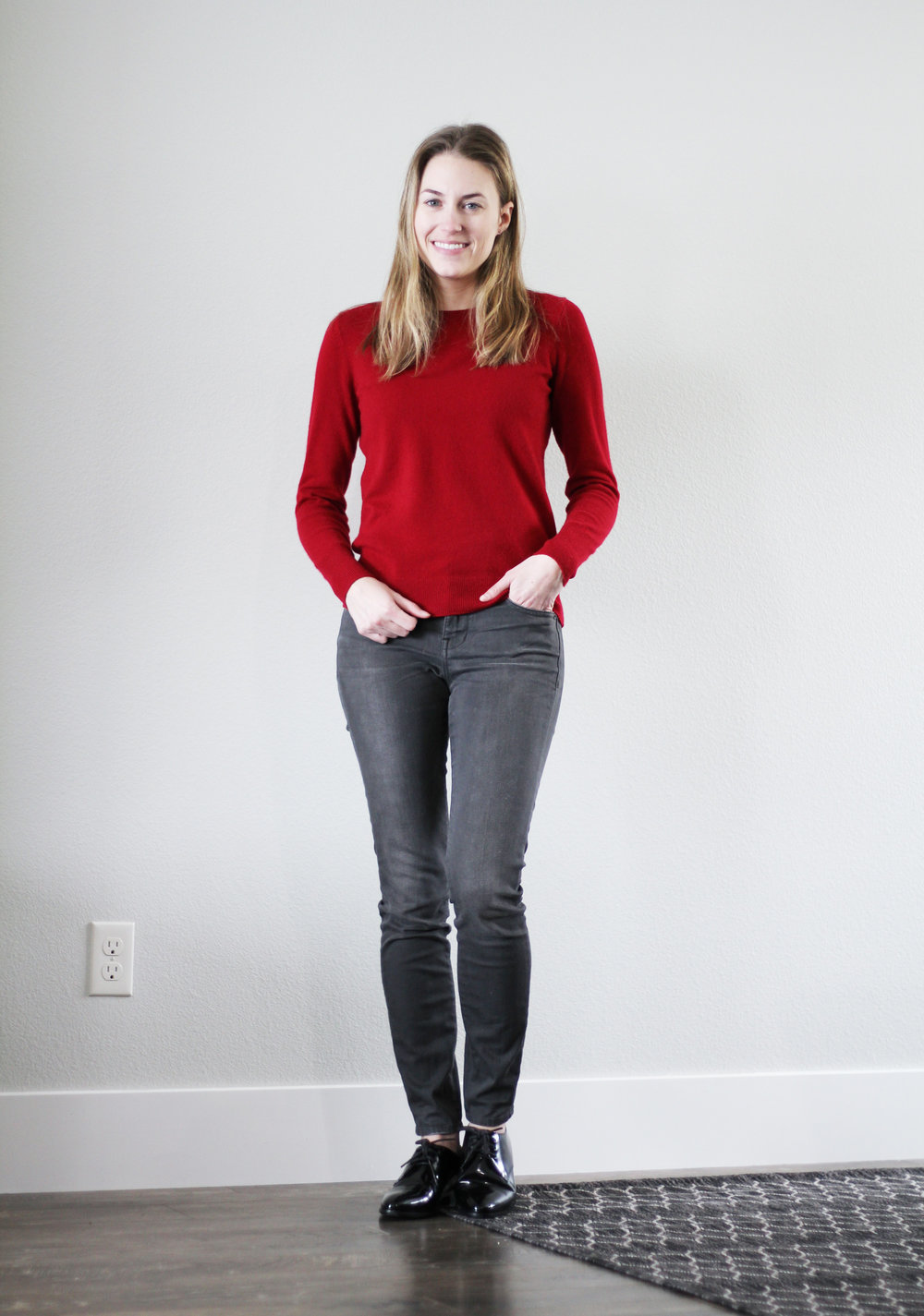 Grey skinny jeans outfit with red cashmere sweater and shiny black oxfords — Cotton Cashmere Cat Hair