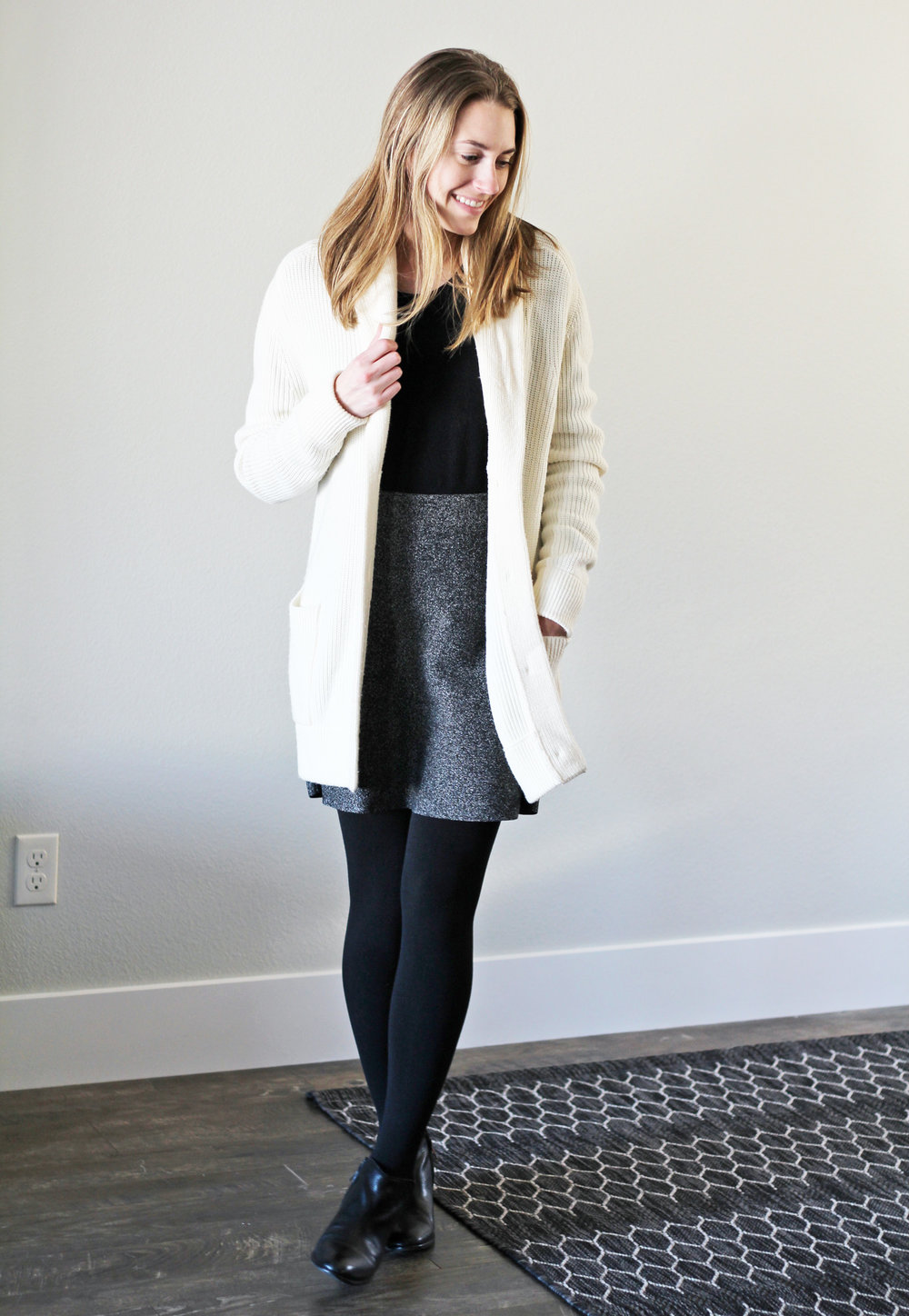 Ivory chunky knit cardigan layered over black sweater — Cotton Cashmere Cat Hair