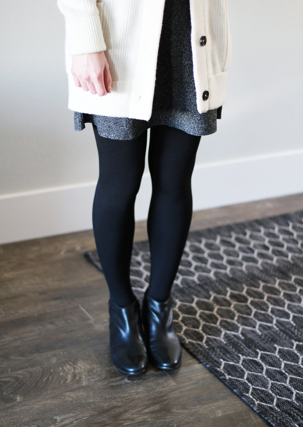 Ivory cardigan, speckled skirt, black ankle boots — Cotton Cashmere Cat Hair