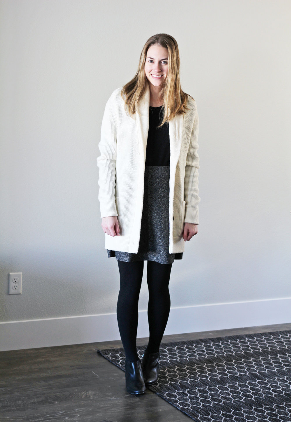 Winter 10x10: Ivory chunky knit cardigan, black sweater, speckled skirt, black ankle boots — Cotton Cashmere Cat Hair