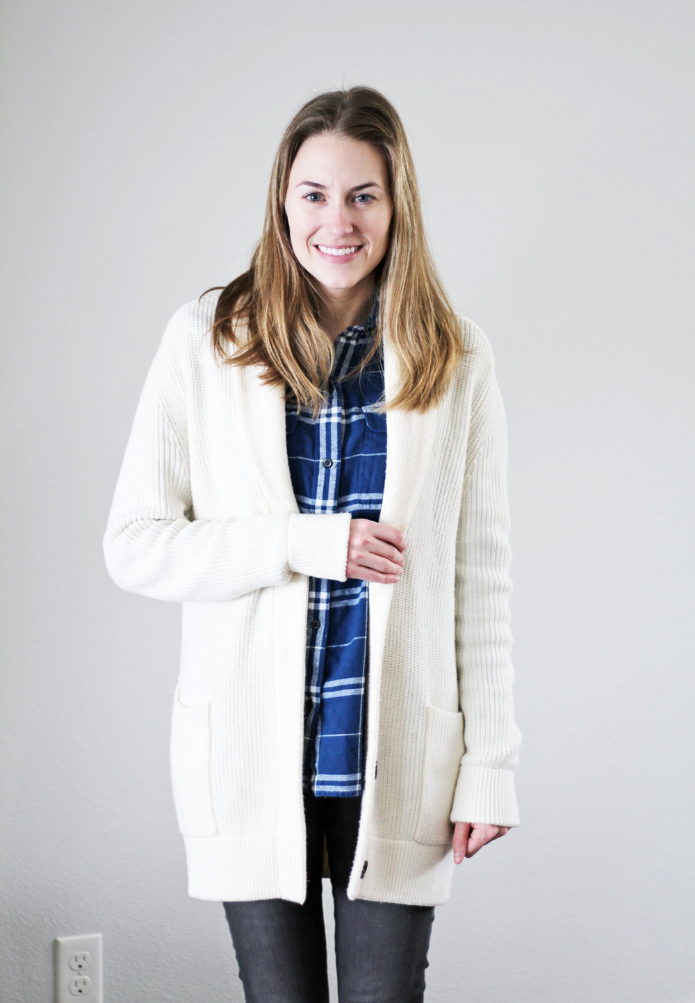 Ivory chunky knit cardigan over blue plaid flannel shirt — Cotton Cashmere Cat Hair