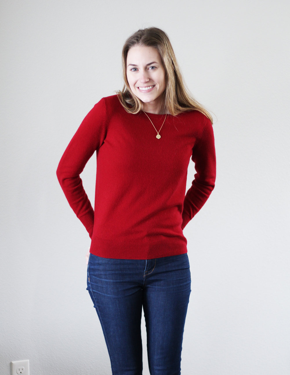 Red cashmere sweater + high-rise skinny jeans — Cotton Cashmere Cat Hair