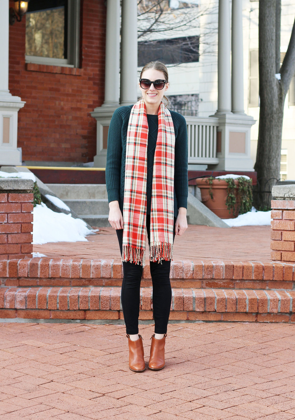 Cream plaid scarf outfit with green sweater, black pants, cognac ankle boots — Cotton Cashmere Cat Hair