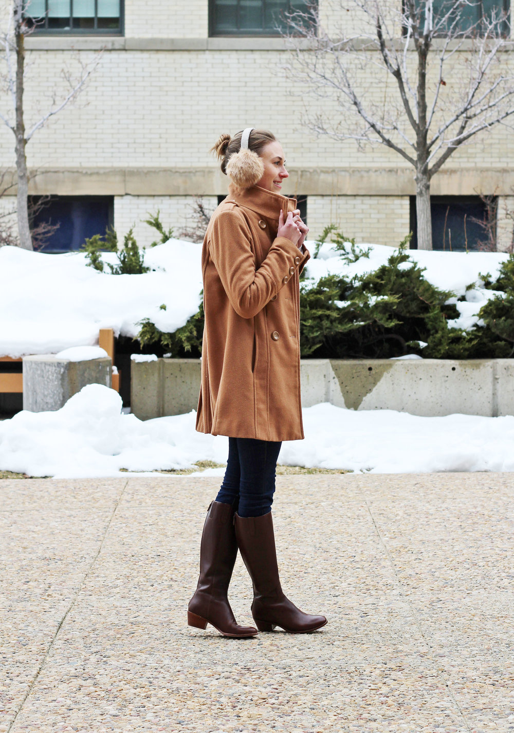 Camel coat outfit with earmuffs and brown tall boots — Cotton Cashmere Cat Hair
