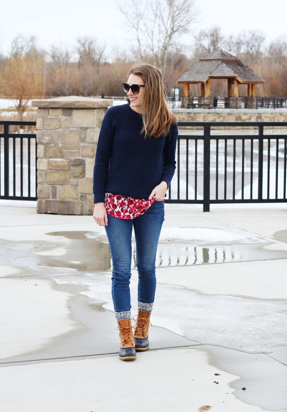 Navy Bean boots outfit with navy sweater layered over red floral top — Cotton Cashmere Cat Hair