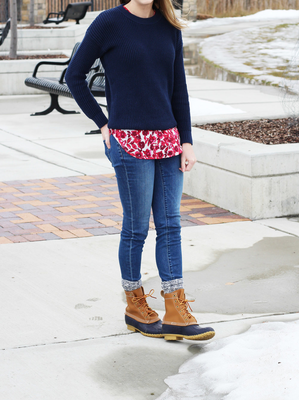 Red floral tank top layered under navy sweater — Cotton Cashmere Cat Hair