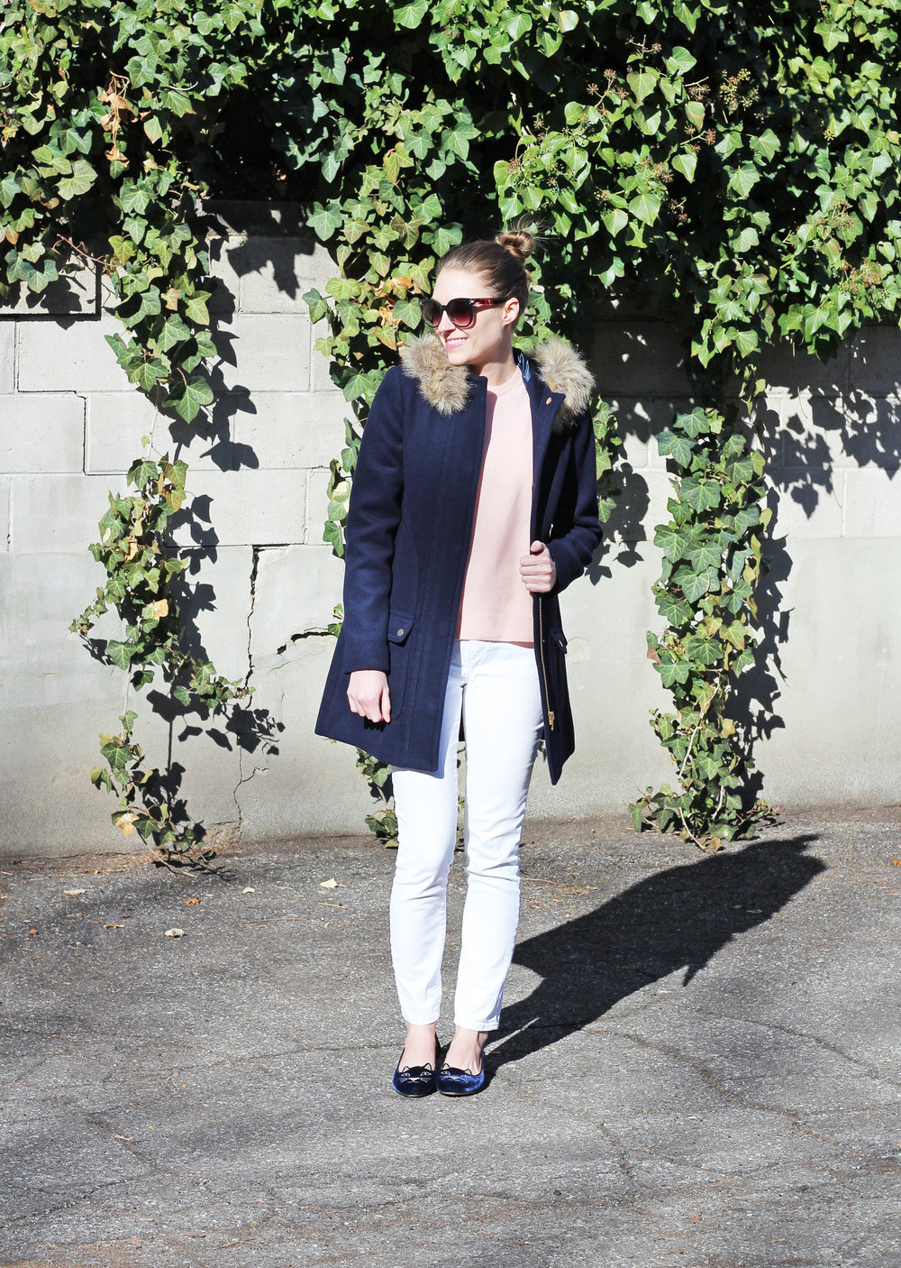 Navy Kitty flats outfit with navy coat, pink sweater, white denim — Cotton Cashmere Cat Hair