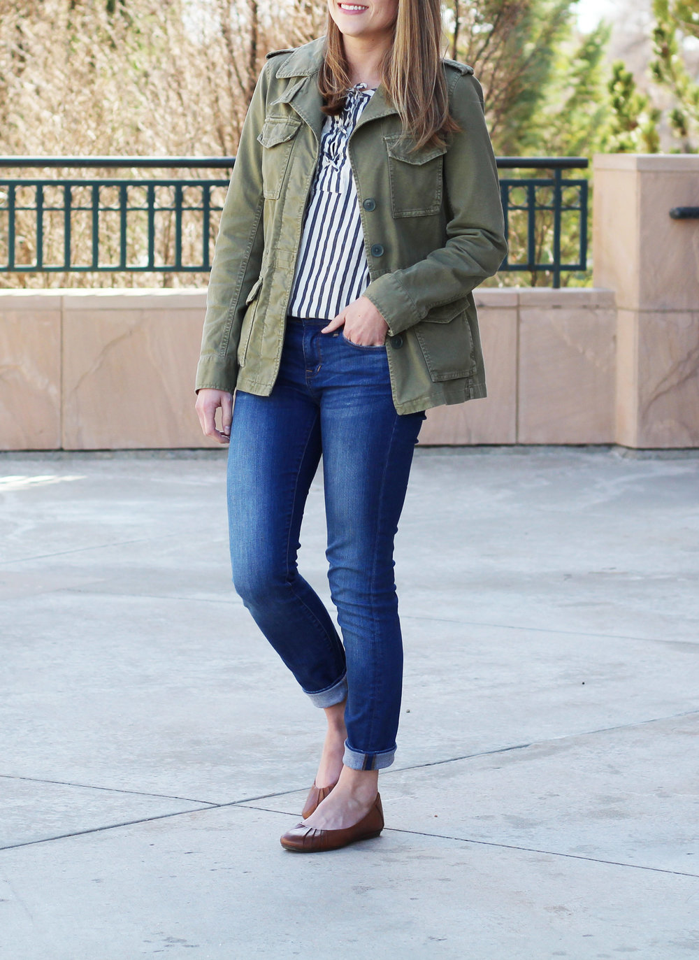 Army green utility jacket, striped lace-up top, skinny jeans, brown flats — Cotton Cashmere Cat Hair